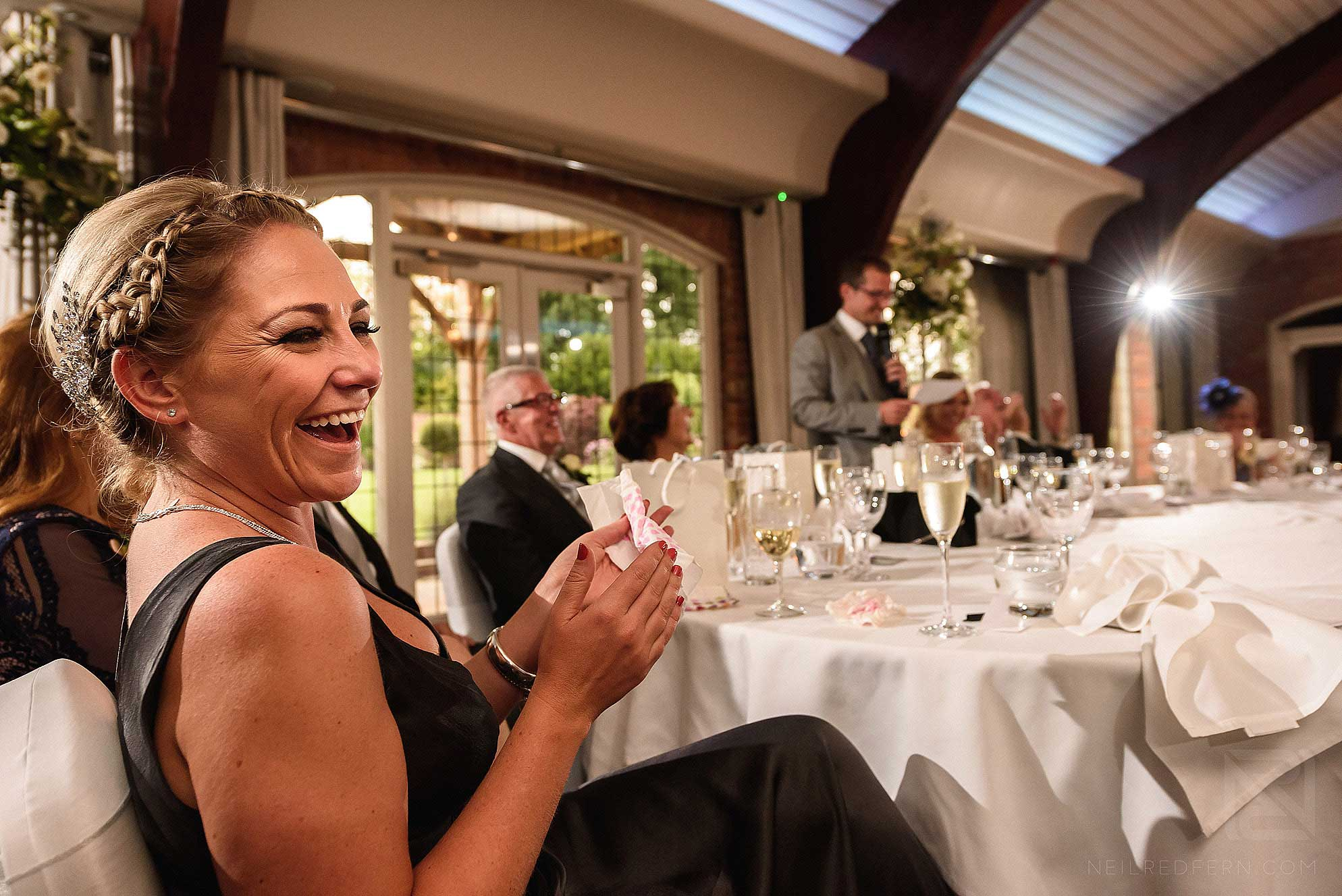 laughing guest at wedding