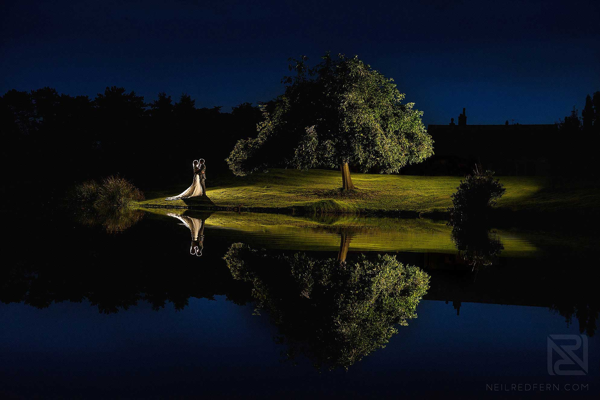 romantic evening photo of bride and groom by tree at Colshaw Hall