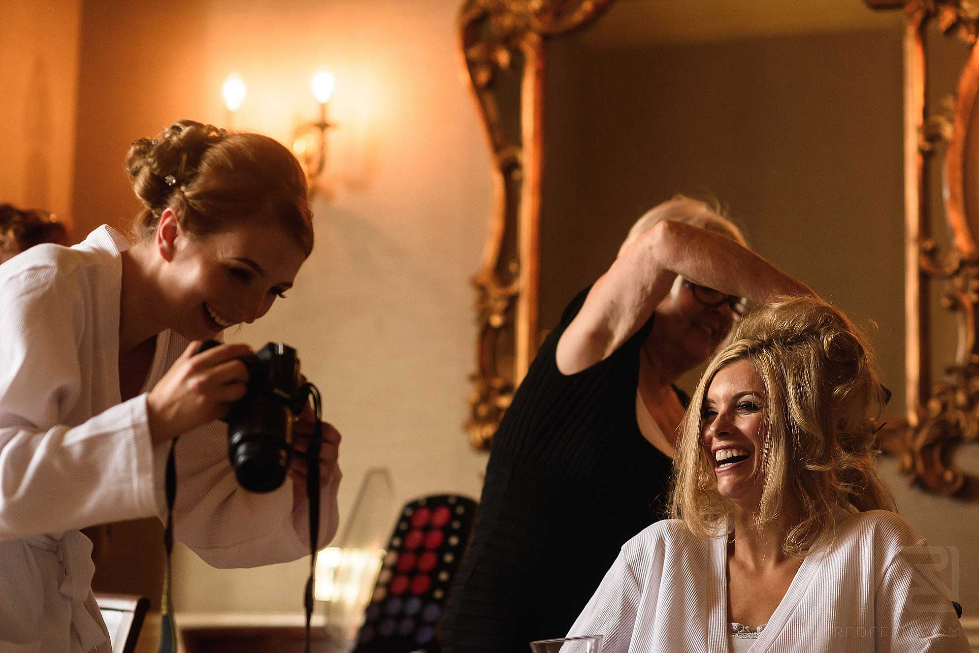 bride laughing whilst getting ready