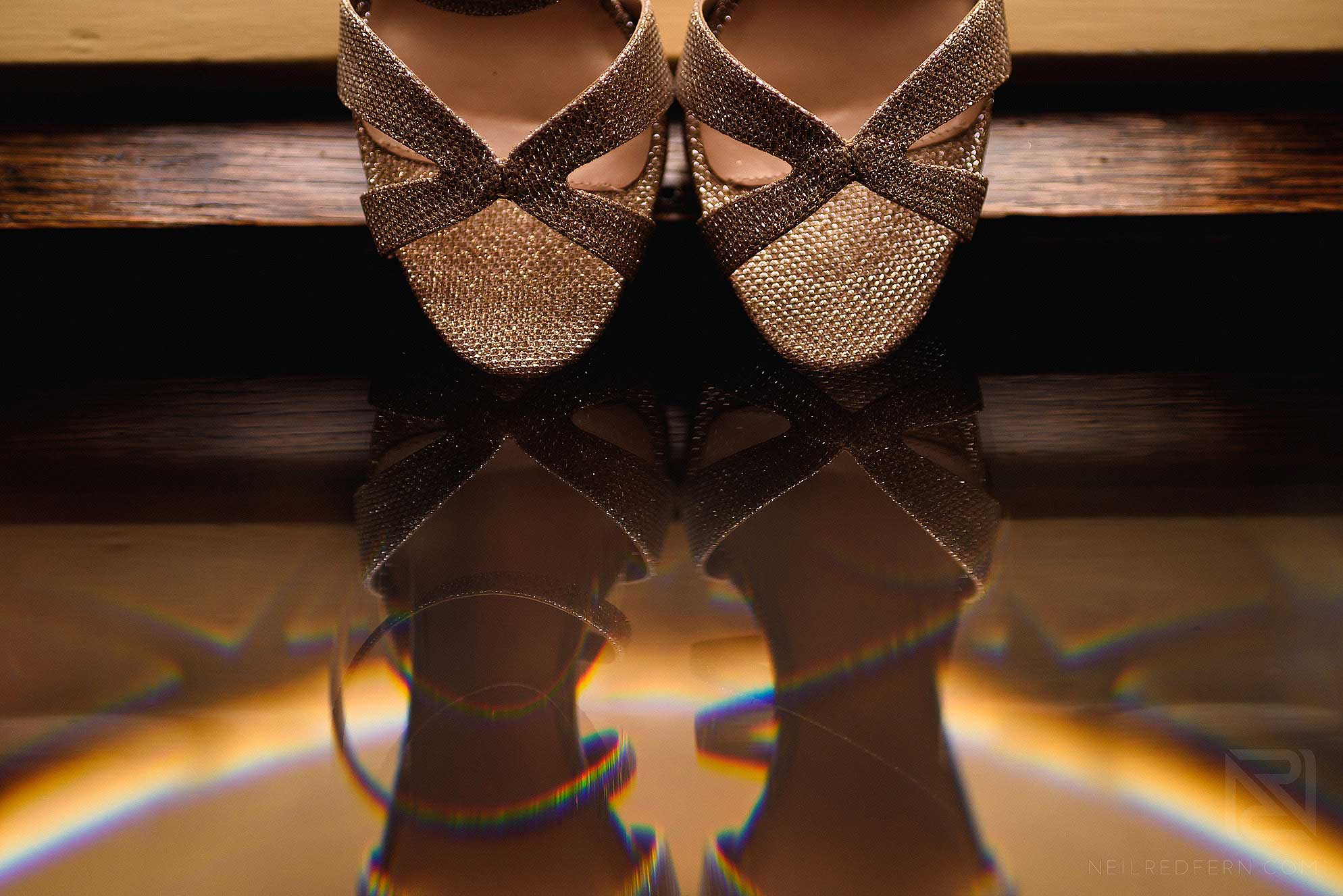 creative photograph of wedding shoes