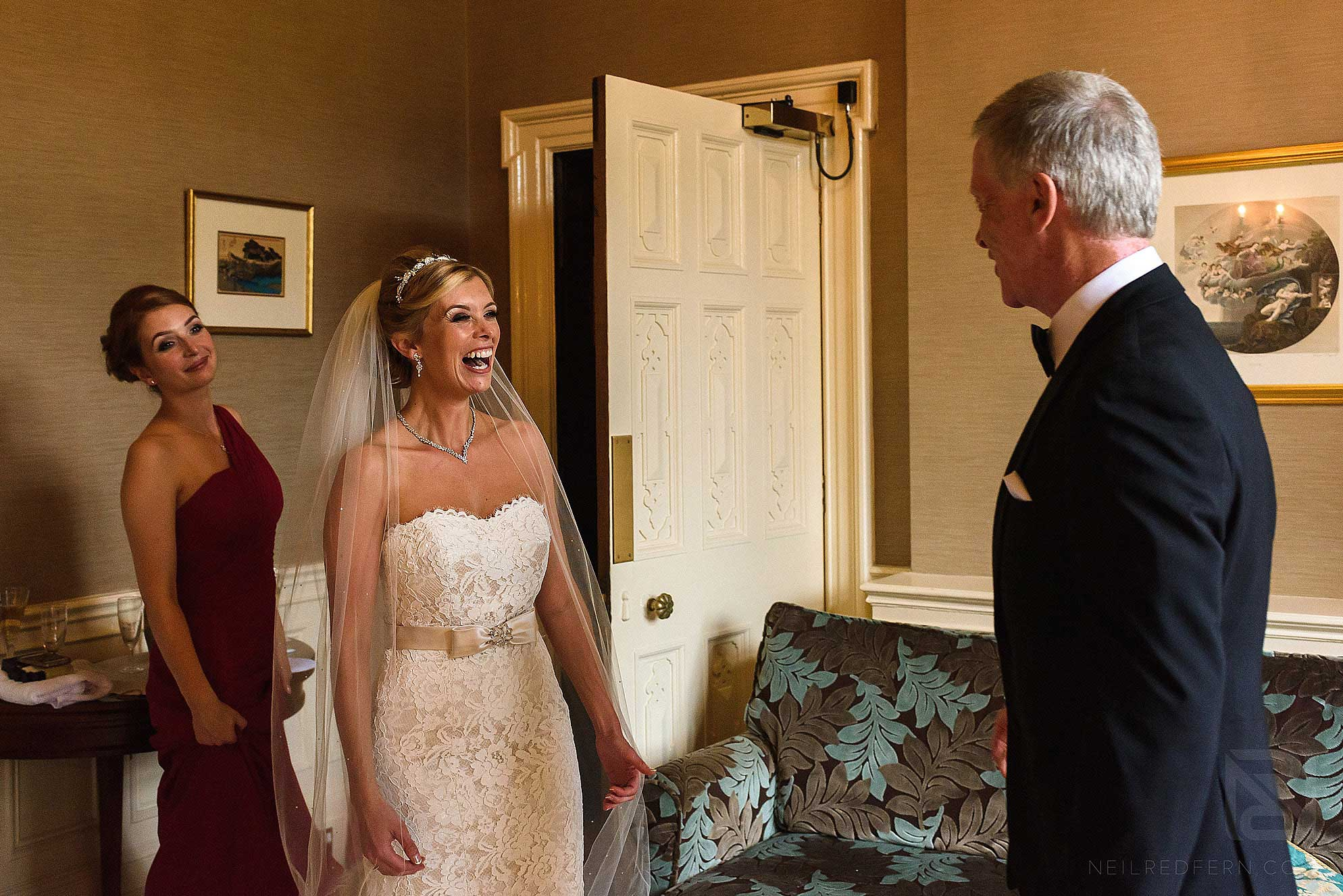 bride looking at dad and smiling
