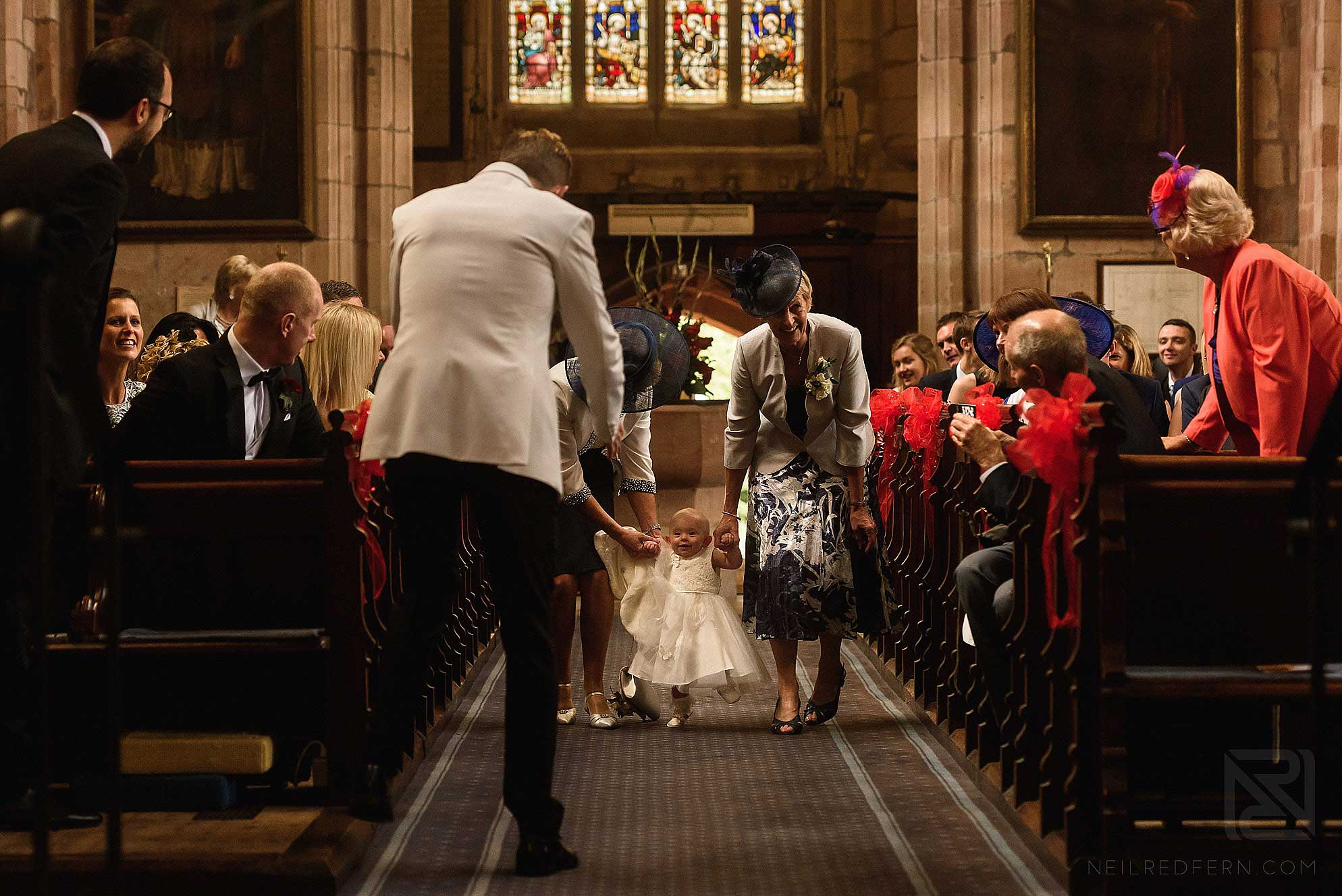 toddler walking down the aisle
