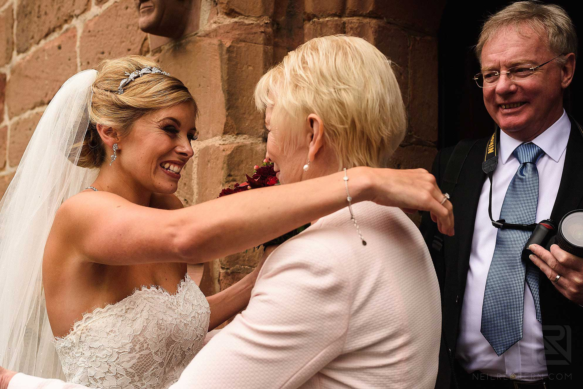 bride and guest smiling