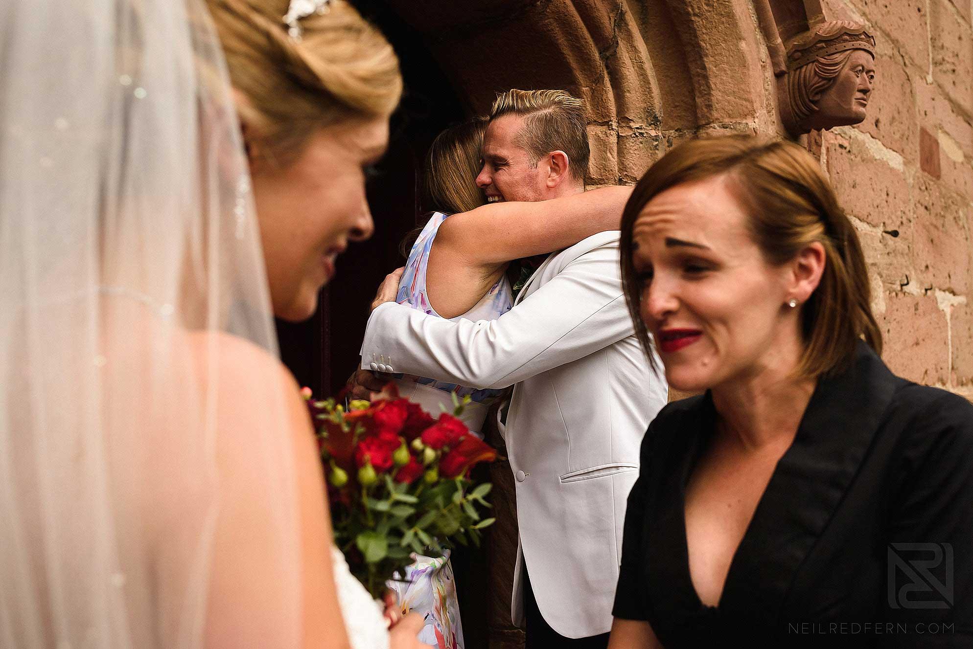 groom hugging friend at church