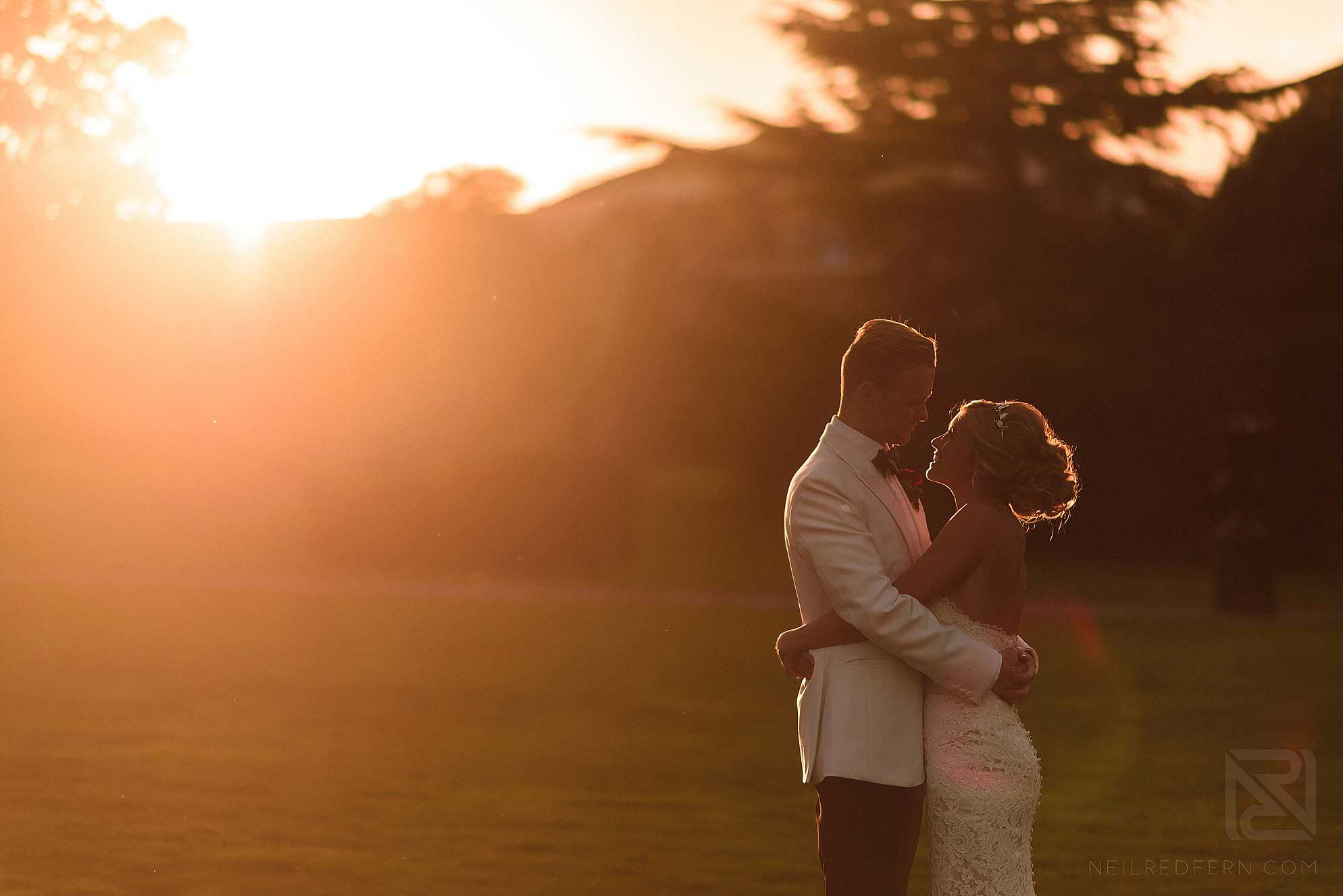 bride and groom together at sunset