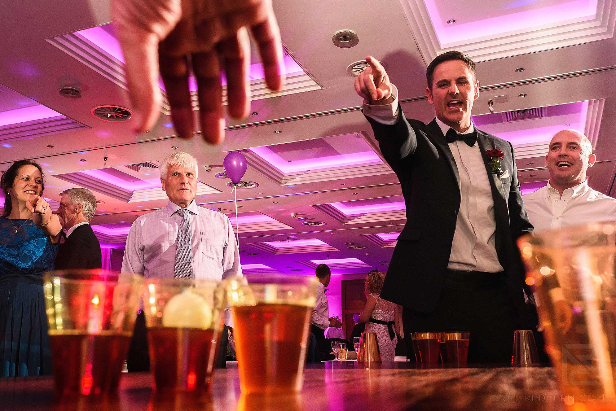 guests playing beer pong at wedding