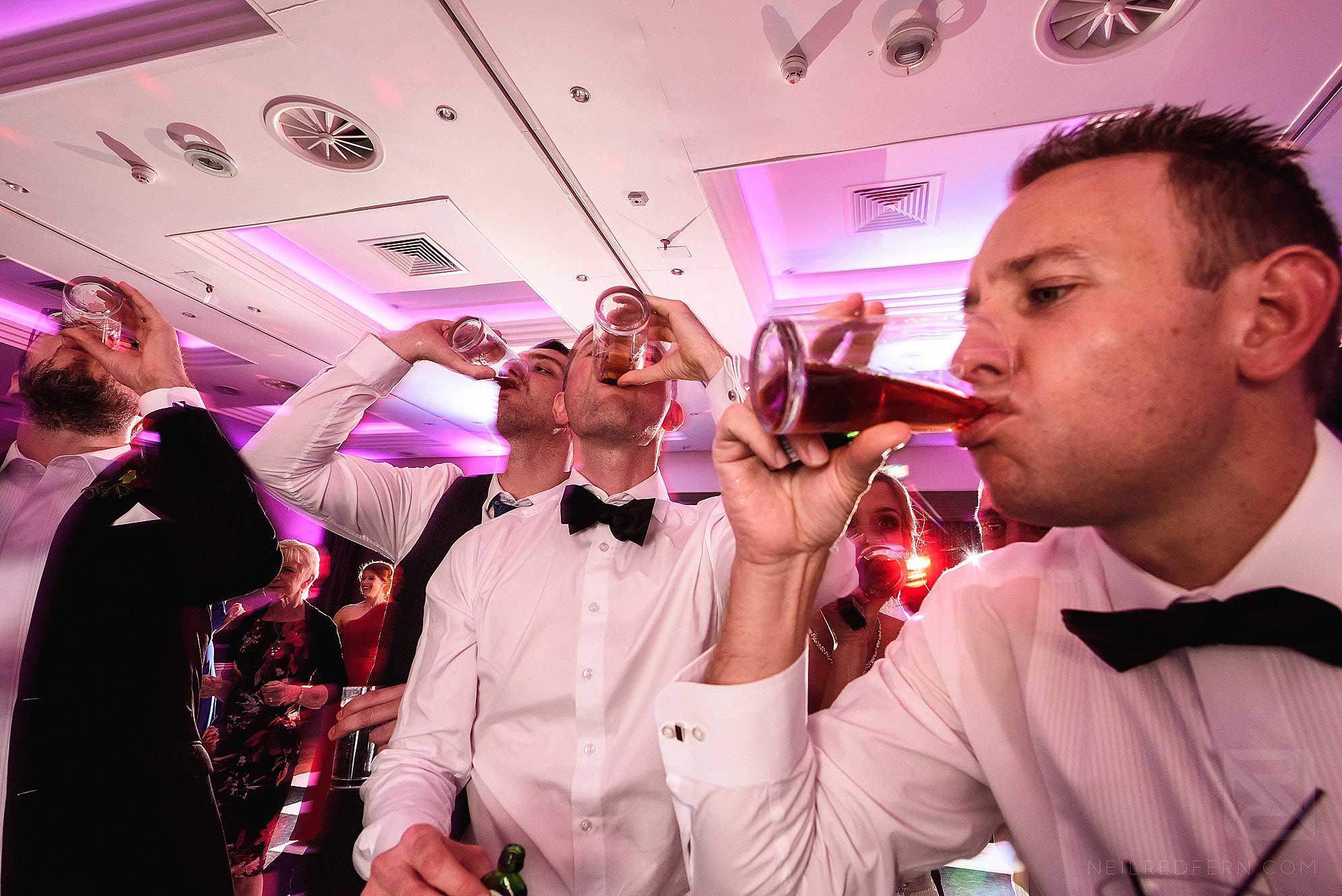 groomsmen drinking shots