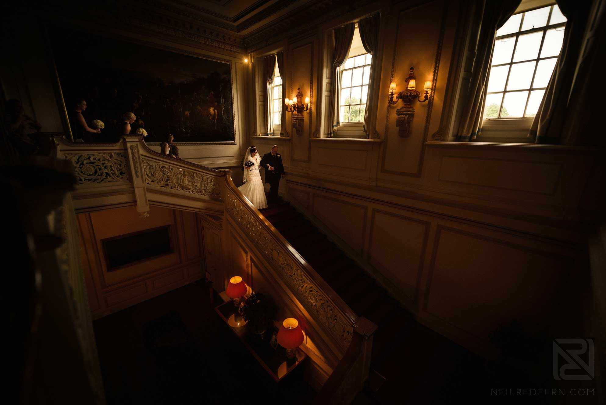 bride and father walking down staircase