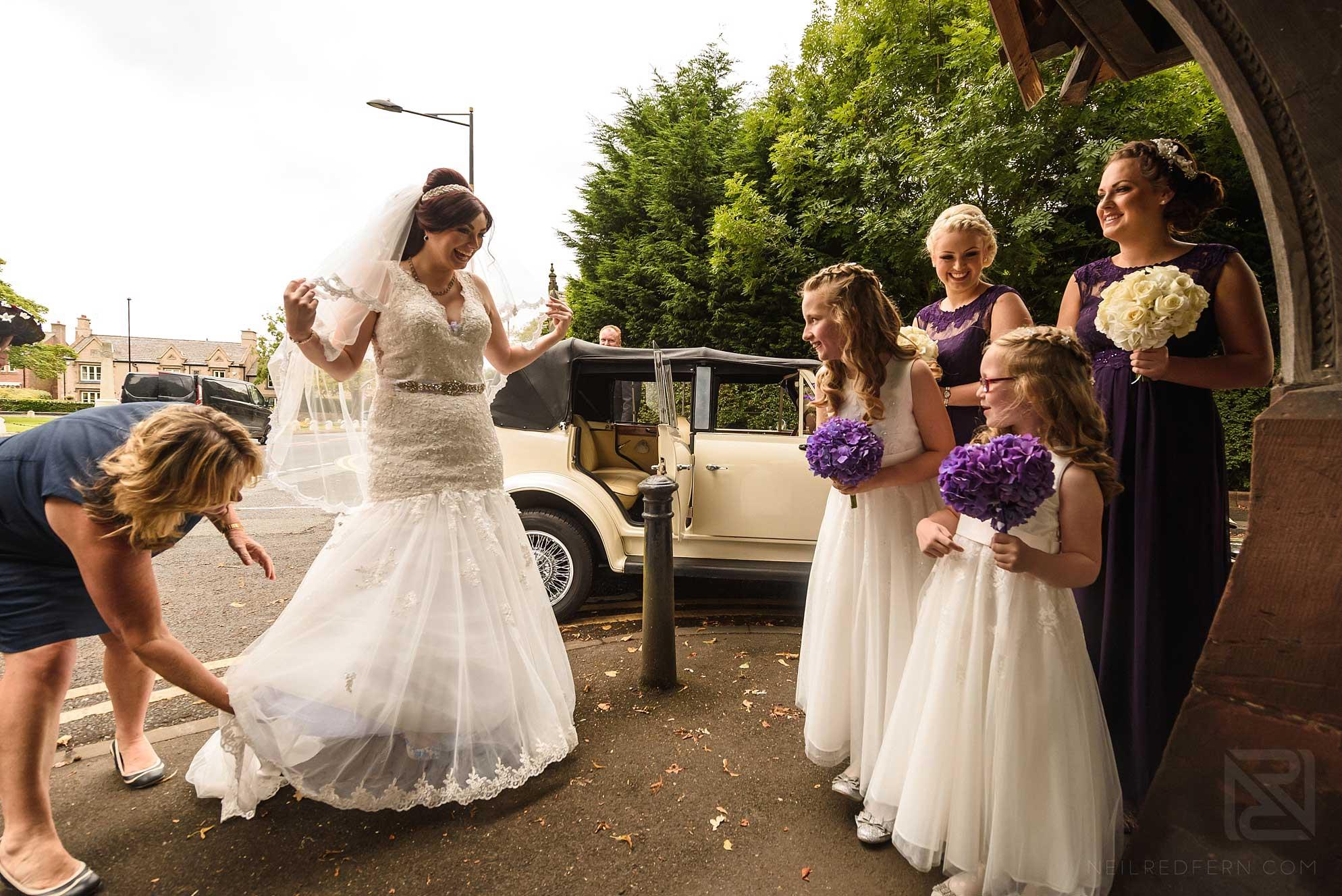 bride and bridesmaids by car