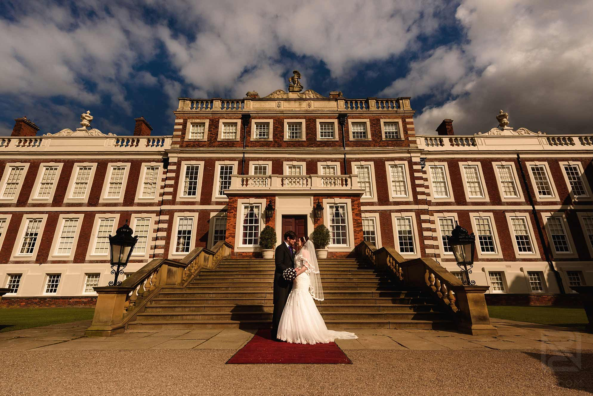 bride and groom stood outside Knowsley Hall