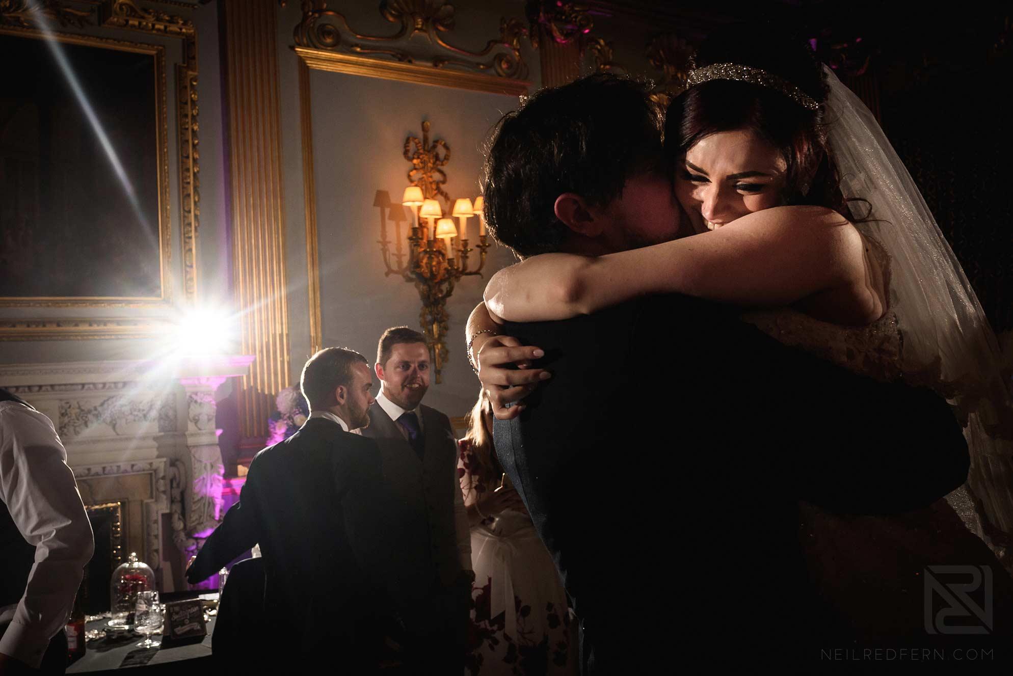bride hugging groom on dancefloor