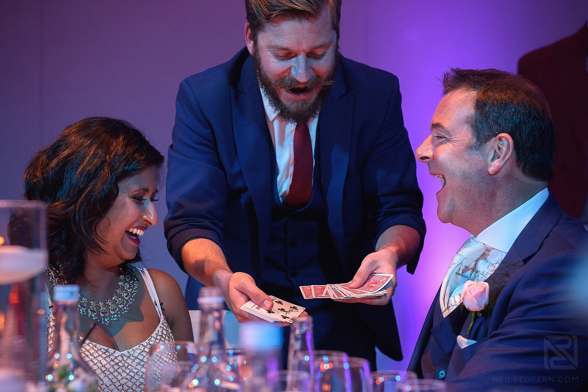 magician doing card trick at wedding
