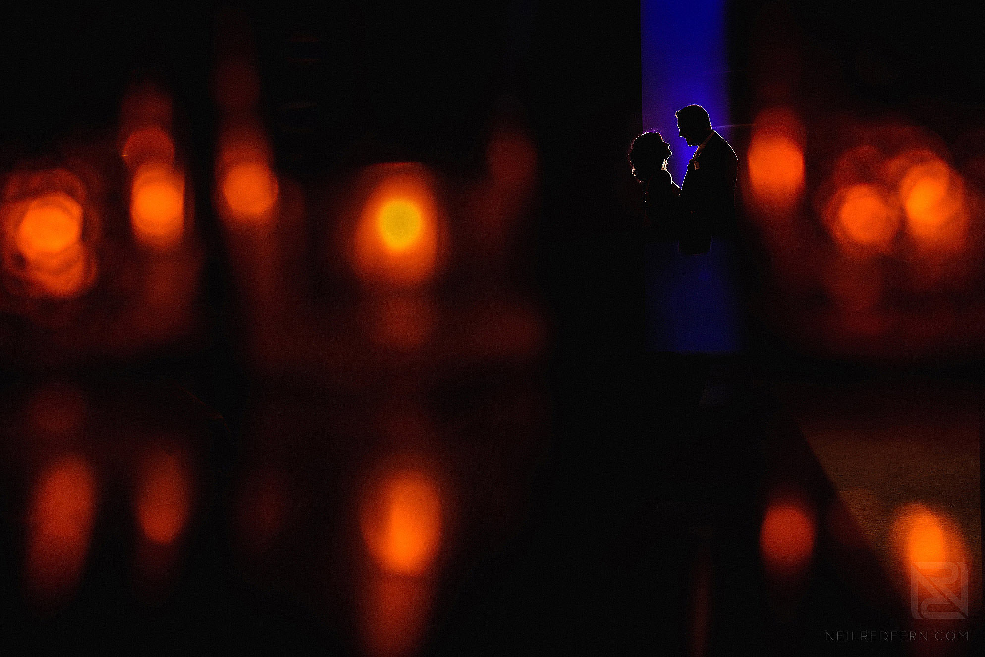 creative silhouette photograph of bride and groom at wedding