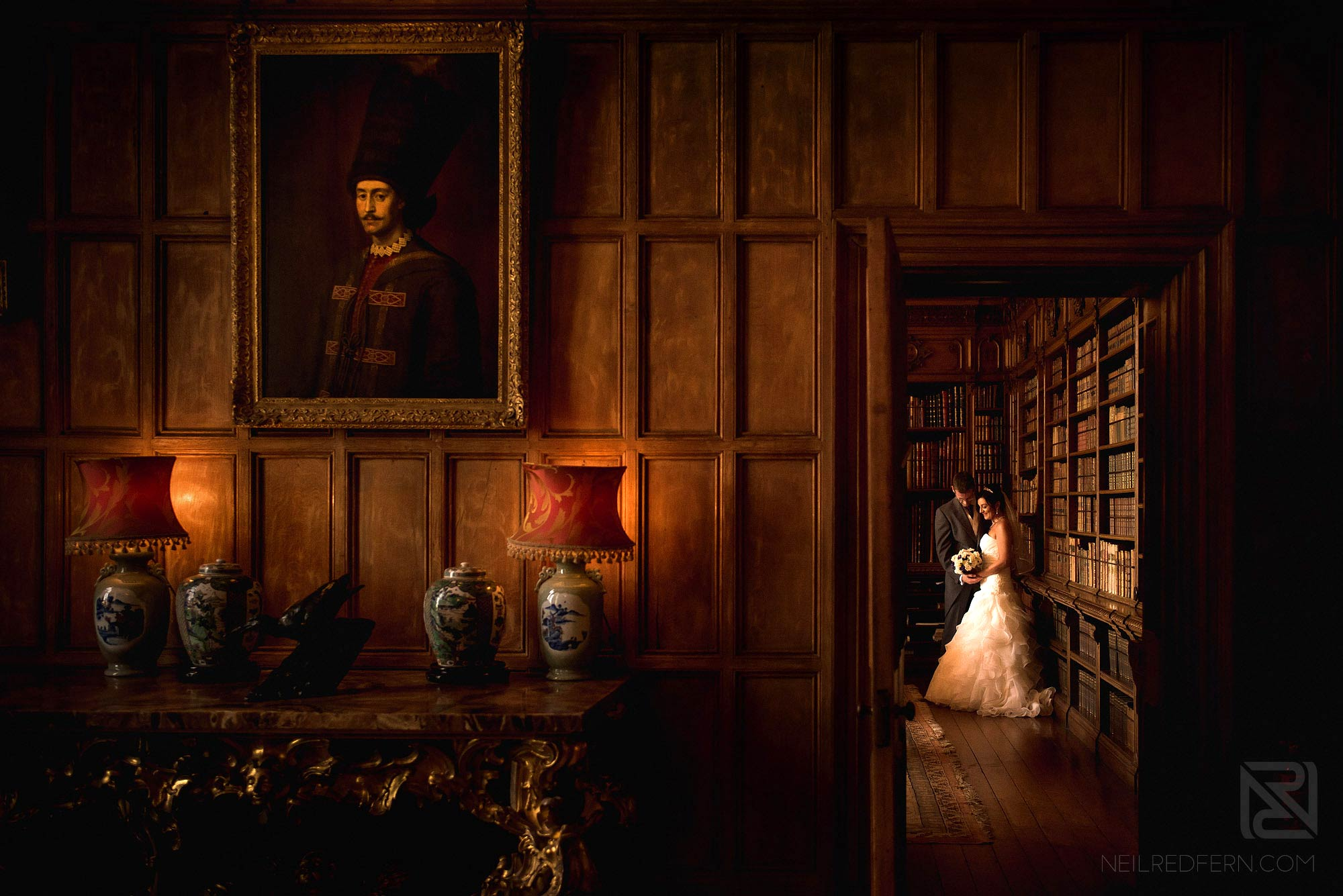 bride and groom in the library at Arley Hall