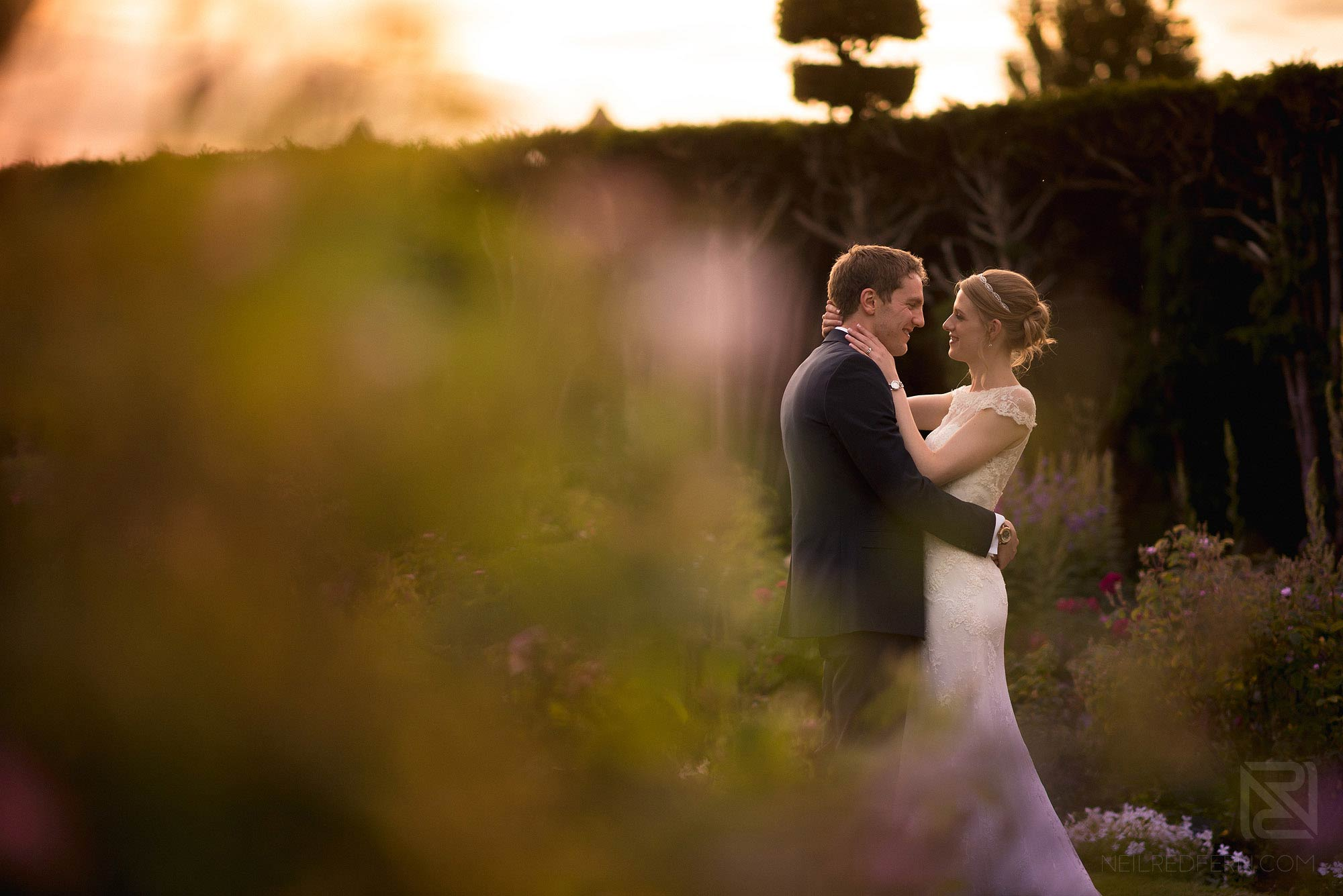 portrait of bride and groom in the gardens at Arley Hall