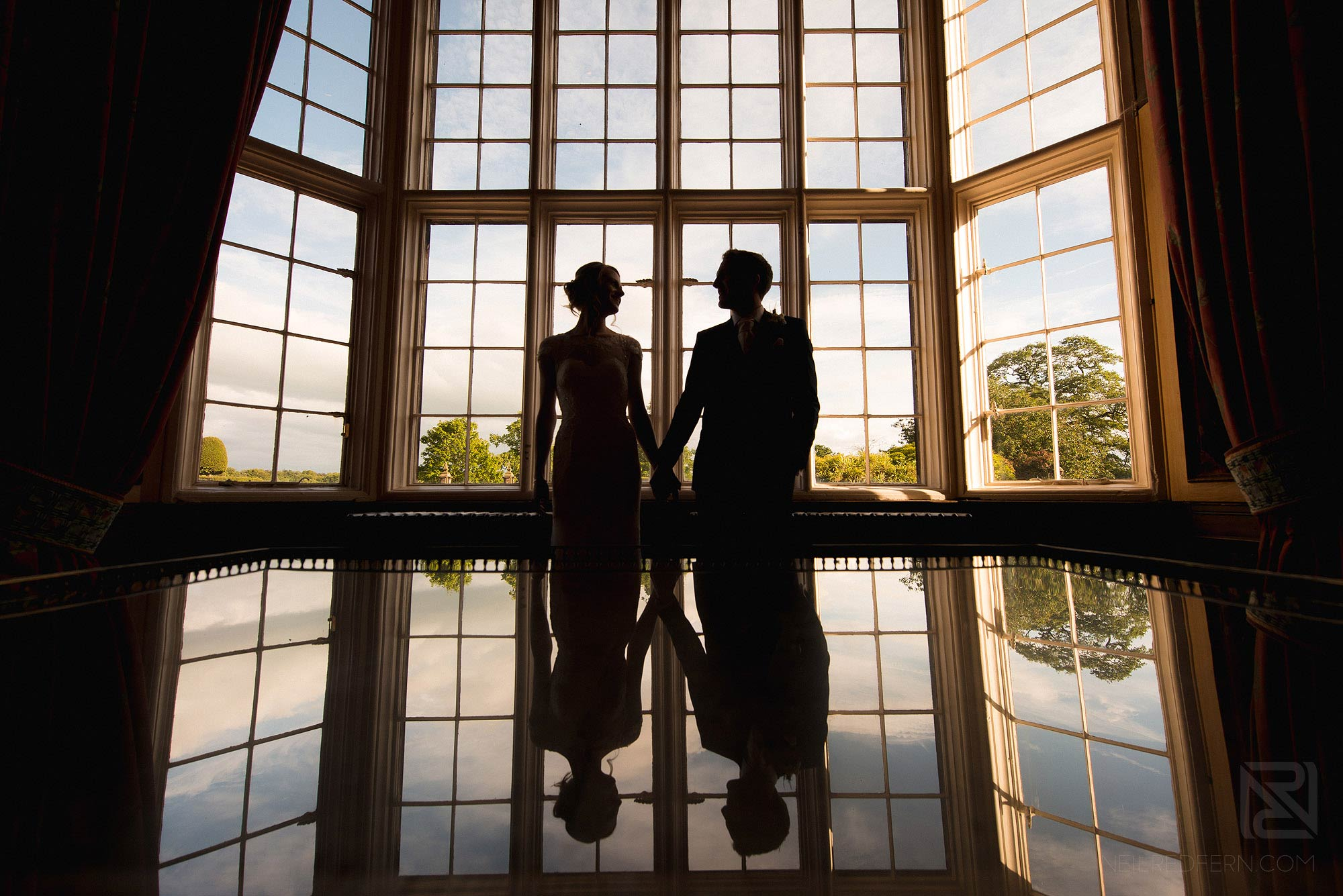 silhouette of couple in Arley Hall library