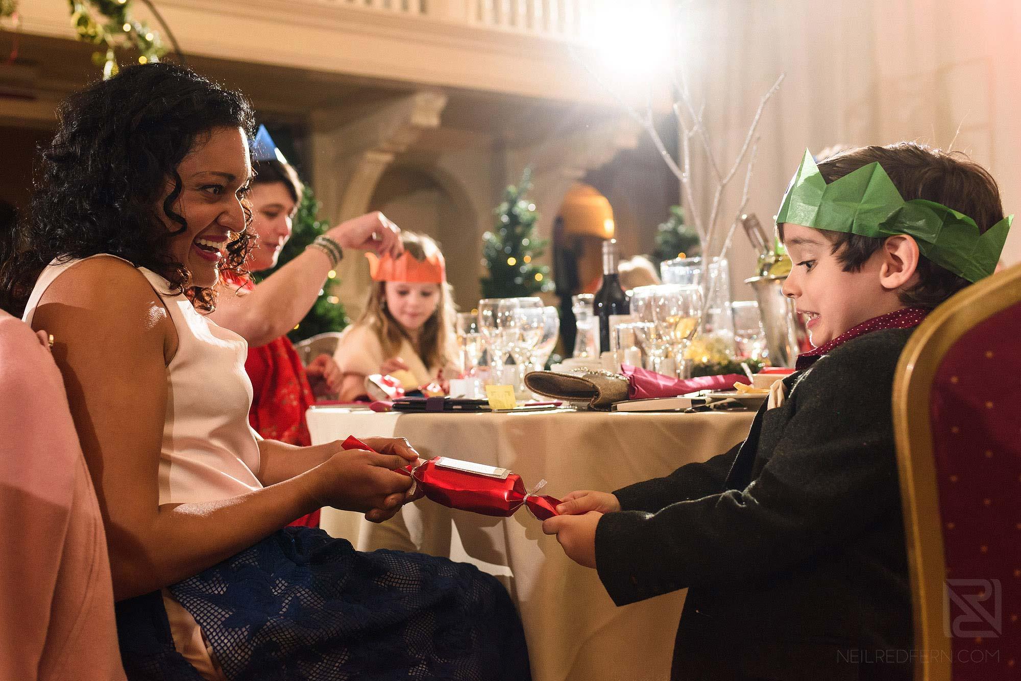 wedding guests pulling cracker at Christmas wedding at The Bowdon Rooms