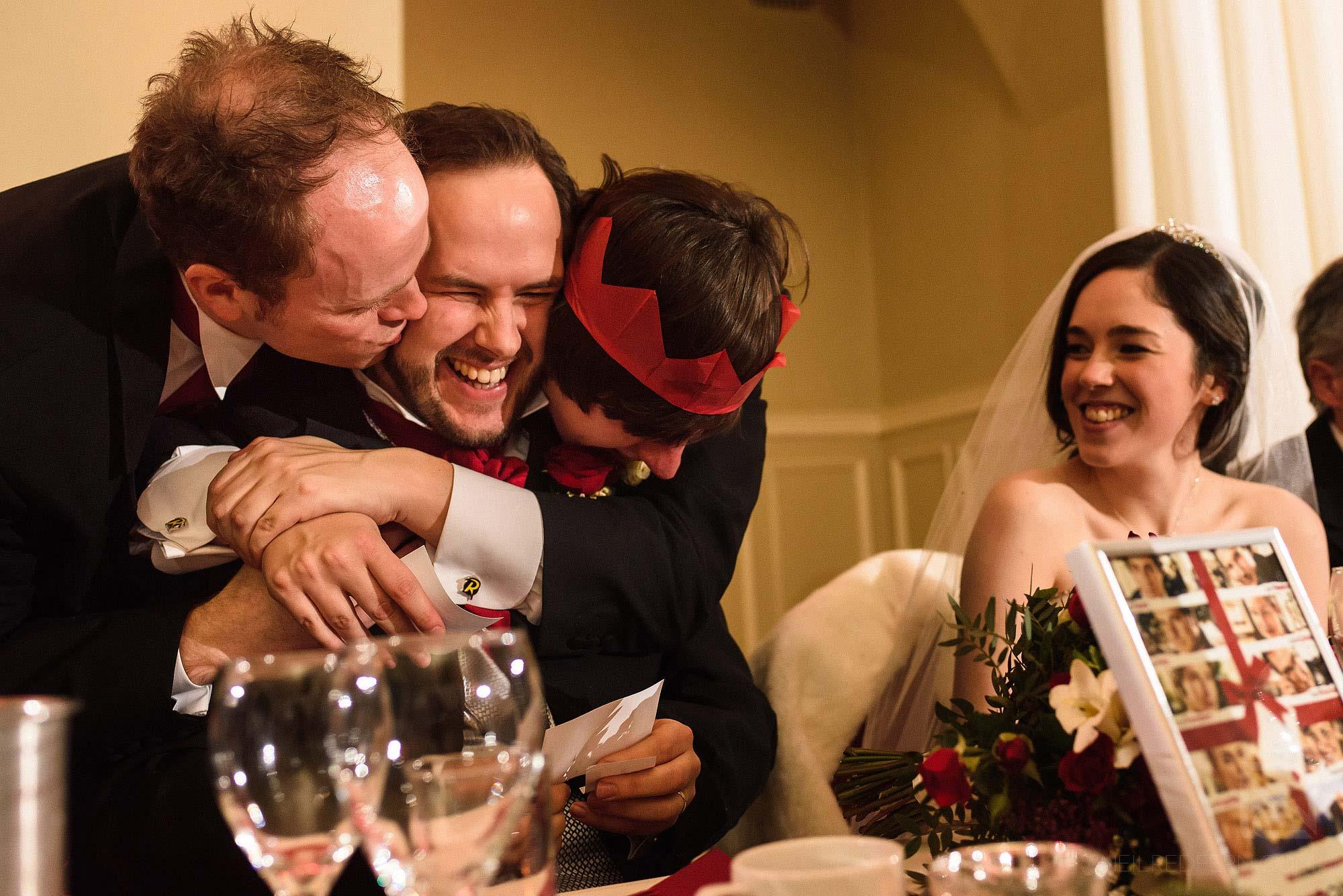 groomsmen kissing groom at wedding at The Bowdon Rooms