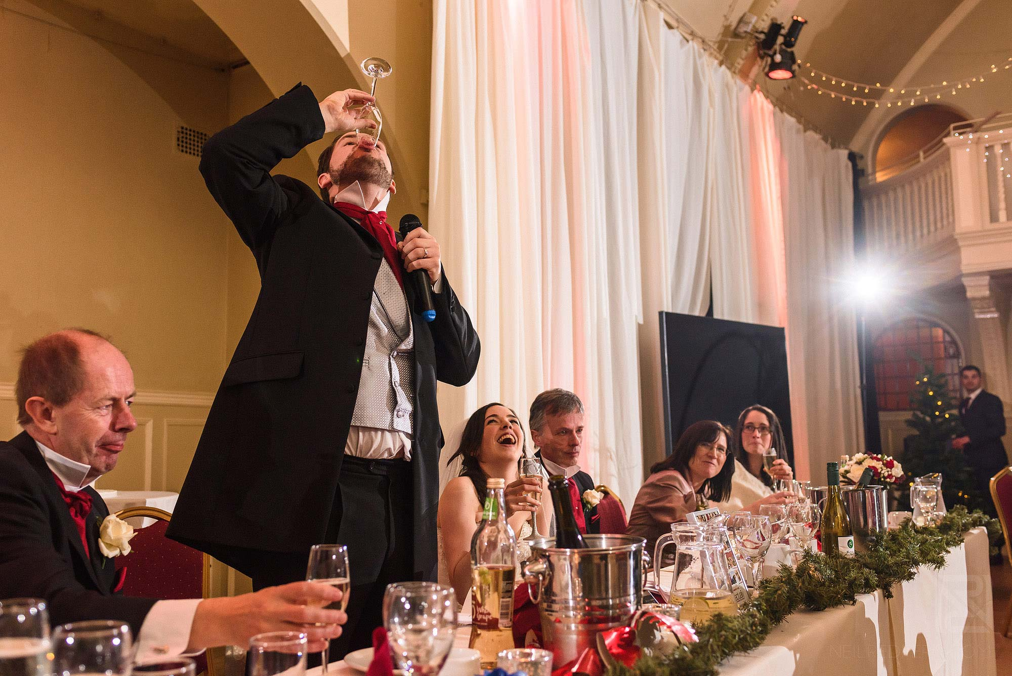 Groom downing drink during speech at The Bowdon Rooms