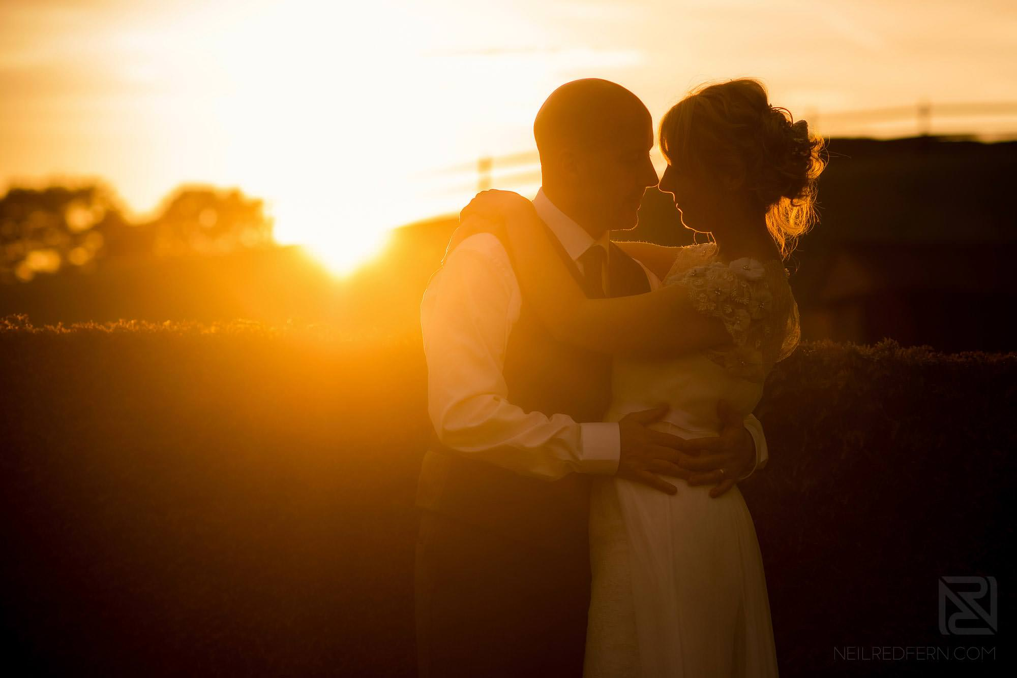 beautiful sunset photograph of bride and groom
