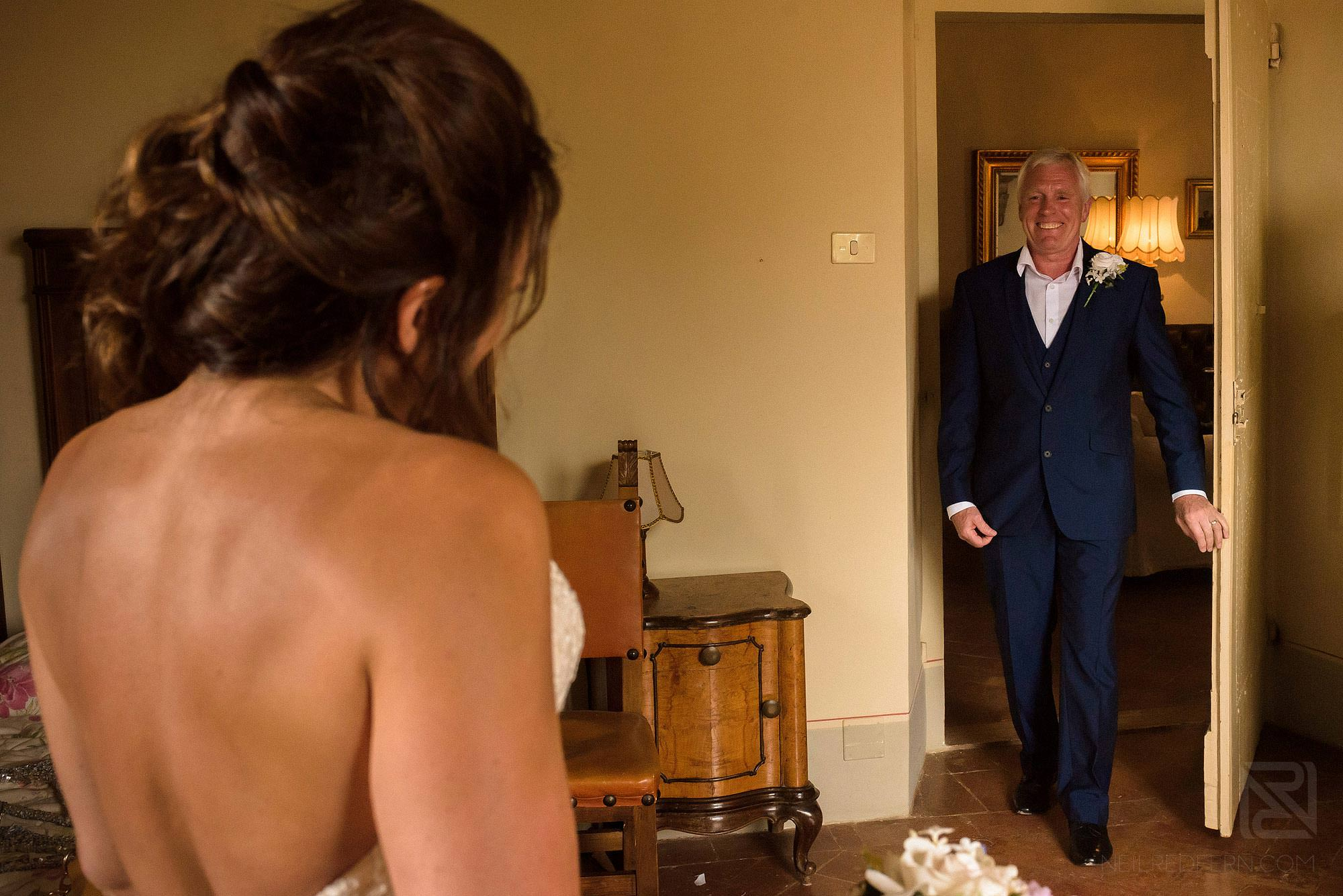 father of bride seeing daughter in dress