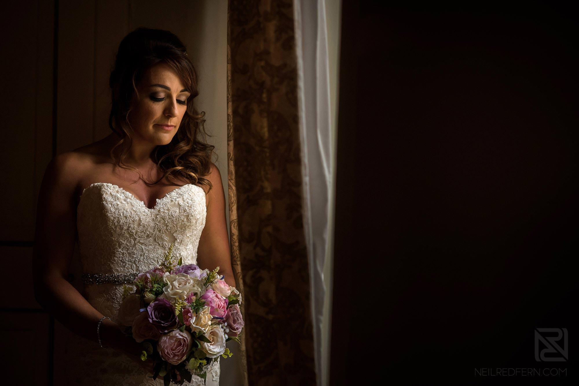 beautiful portrait of bride by window