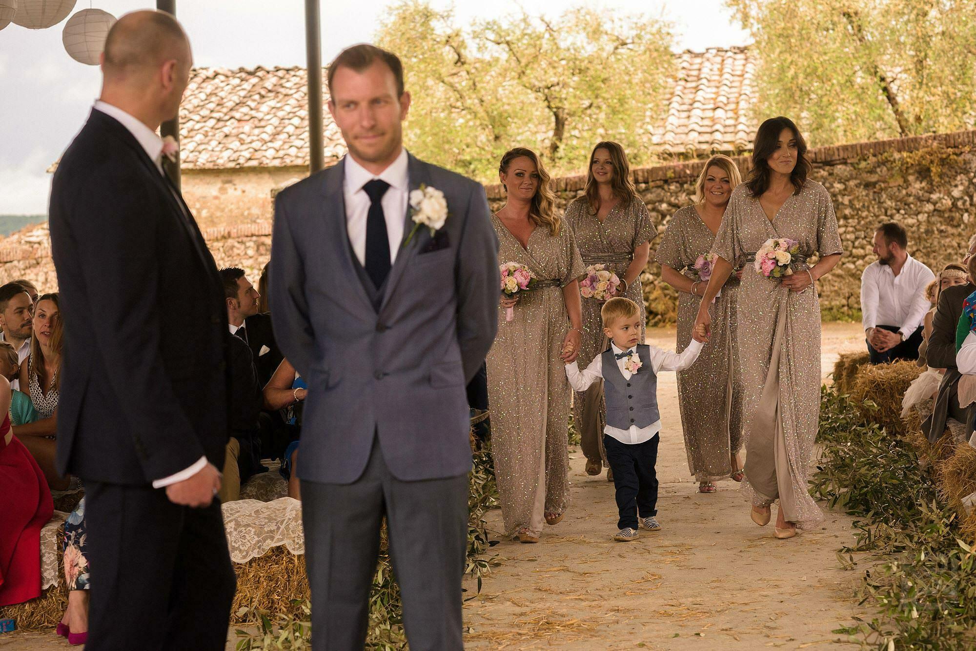 bridesmaids walking down aisle in Tuscany