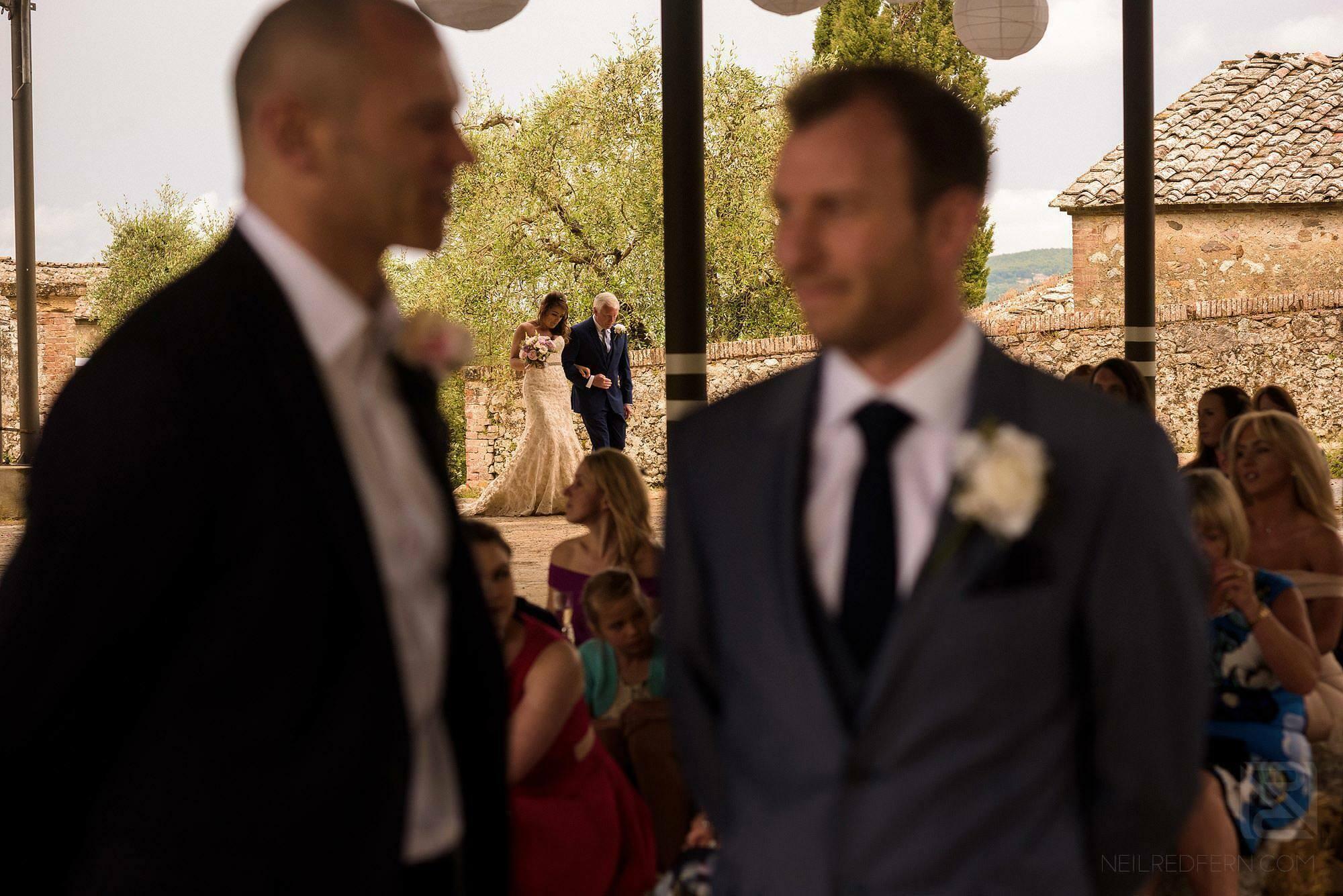 bride walking down aisle in Montestigliano