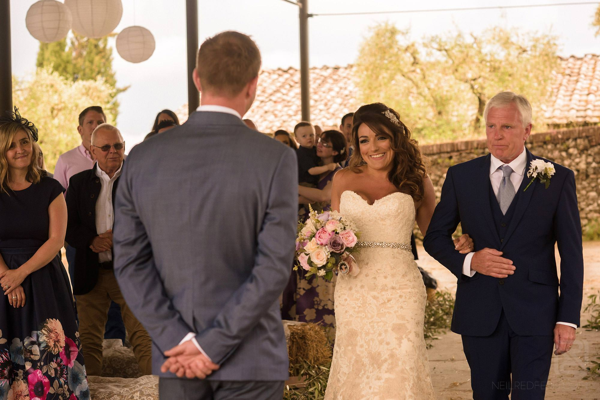bride walking down aisle in Tuscany