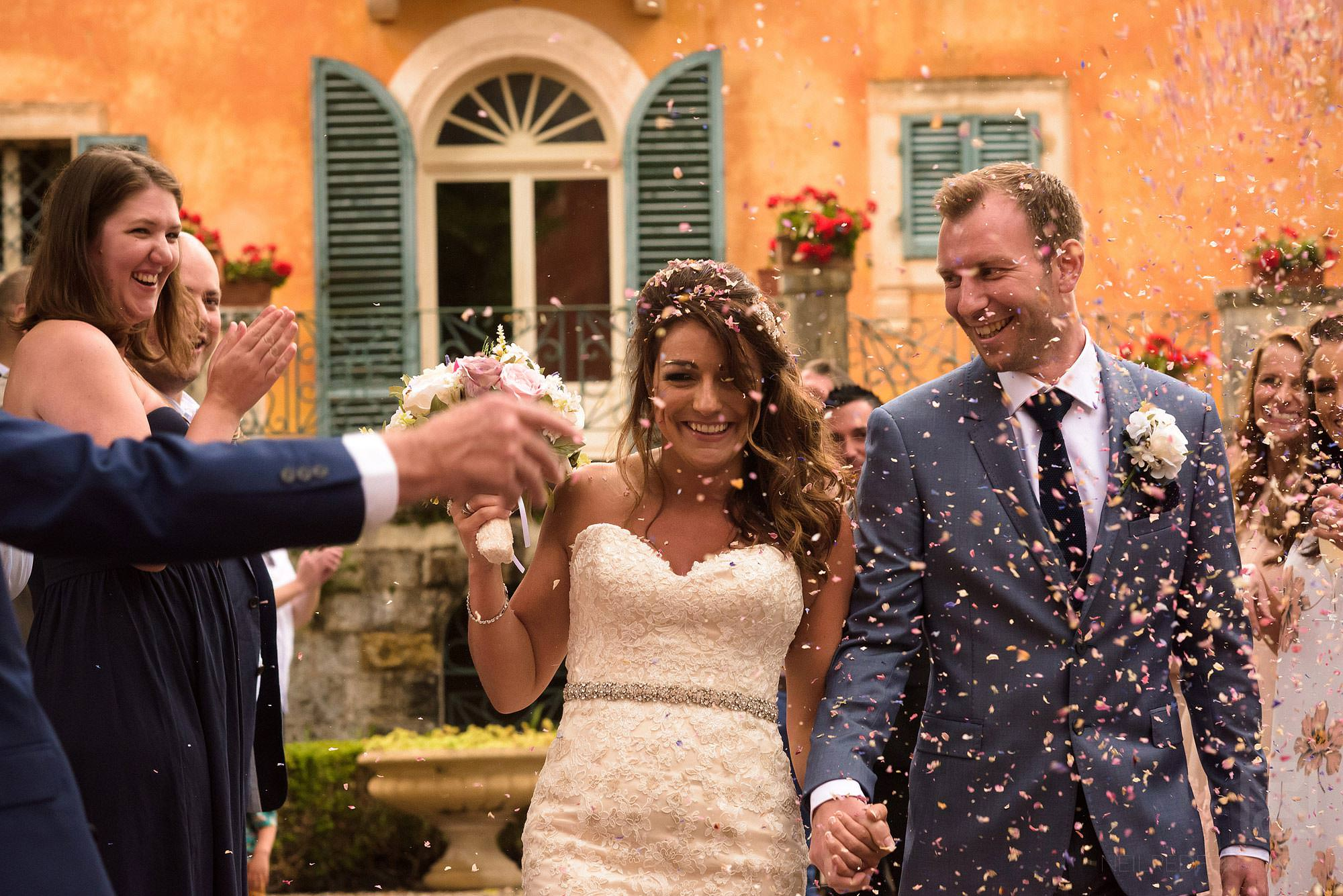 guests throwing confetti in Tuscany