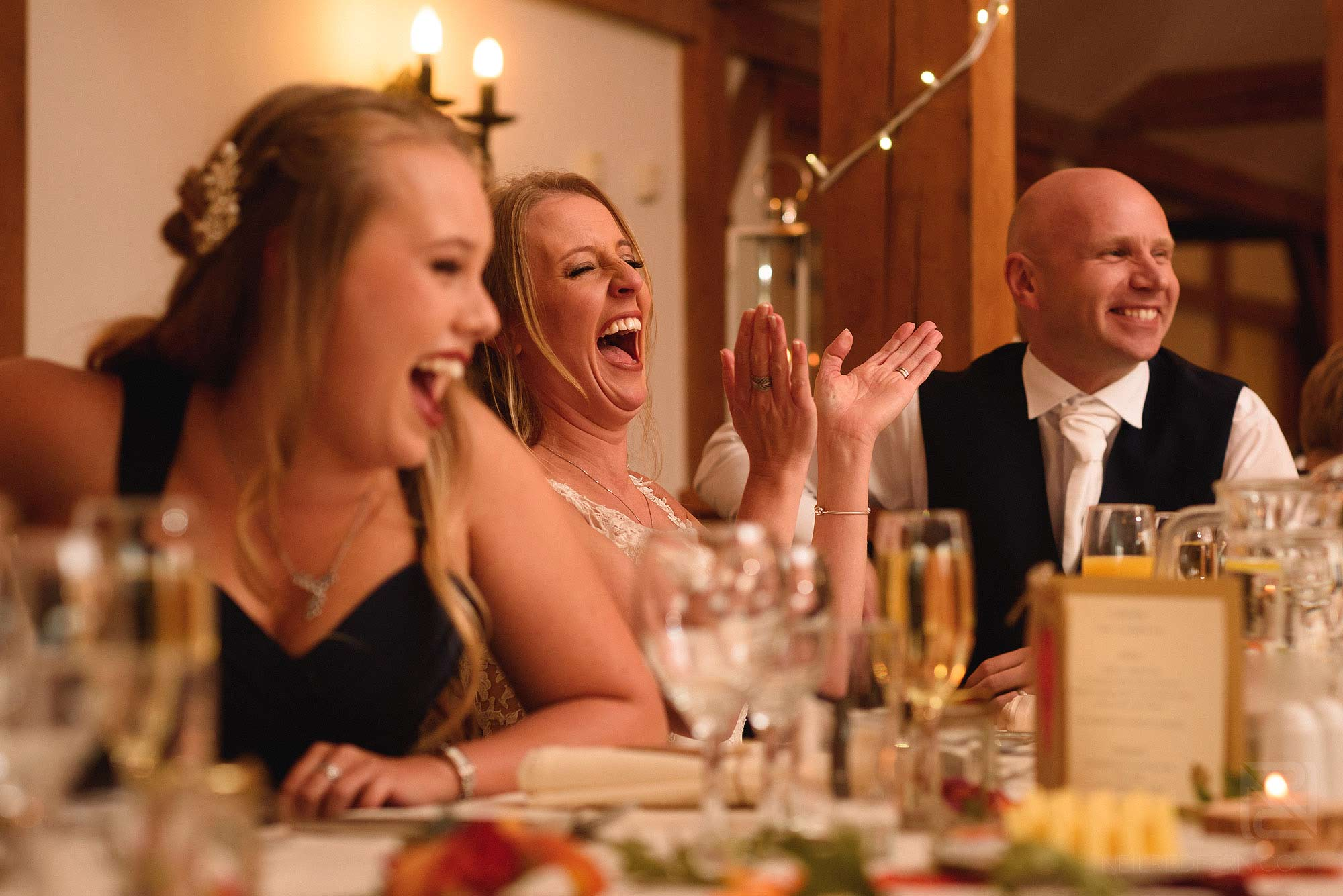 bride laughing durning speeches