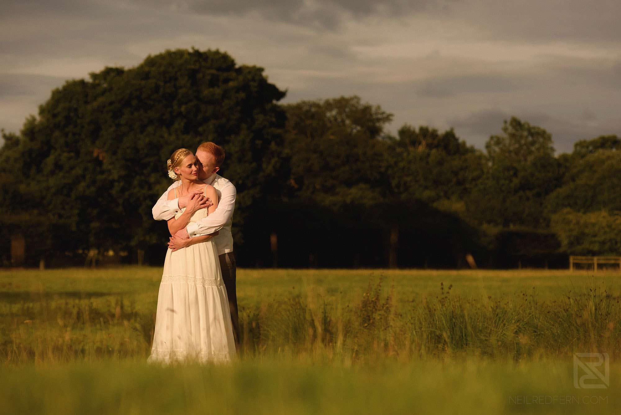 bride and groom hugging at Sandhole Oak Barn