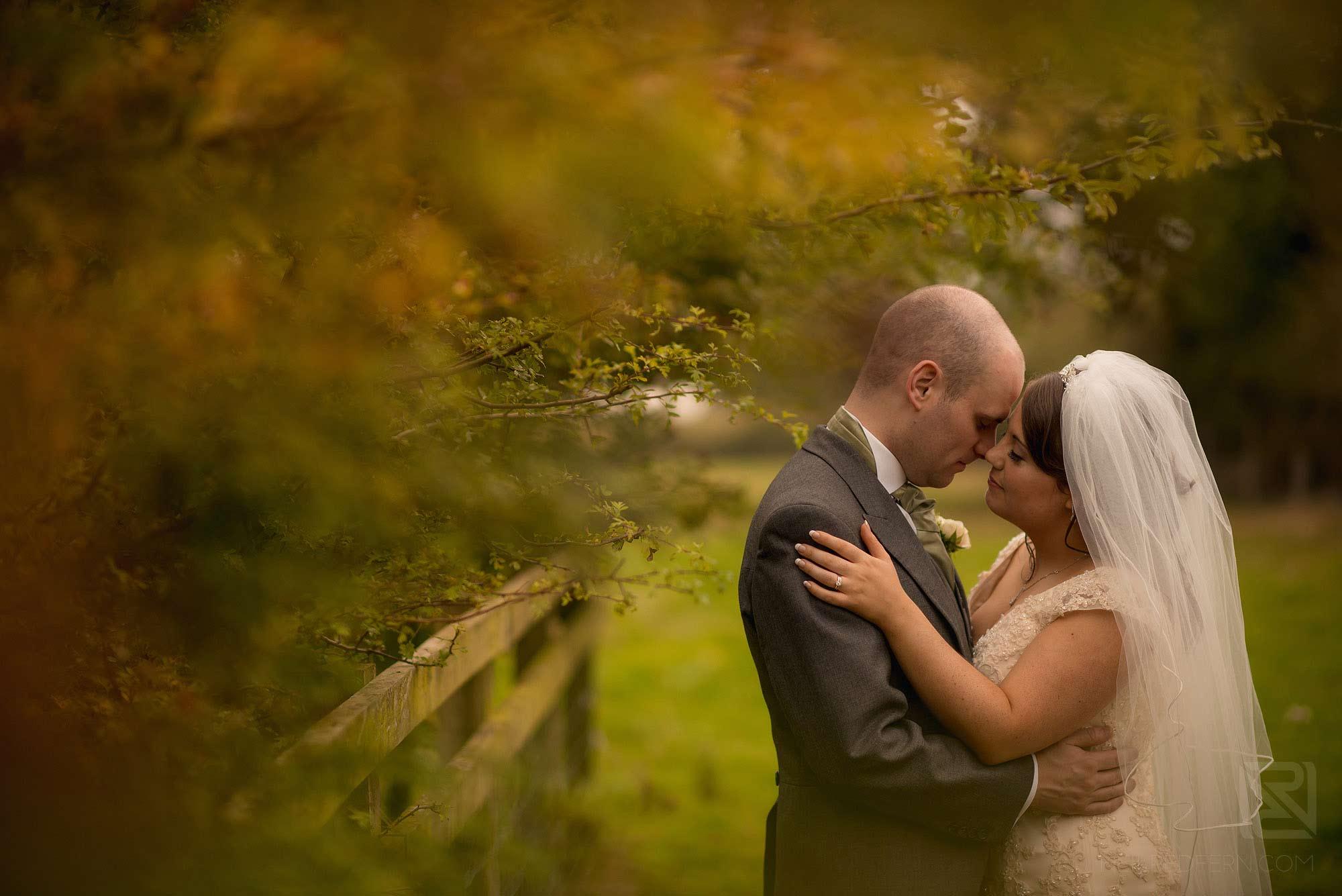 beautiful portrait of bride and groom outside at Sandhole Oak Barn