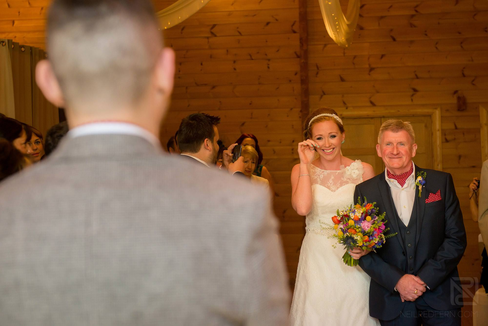 bride getting emotional walking down aisle at Styal Lodge