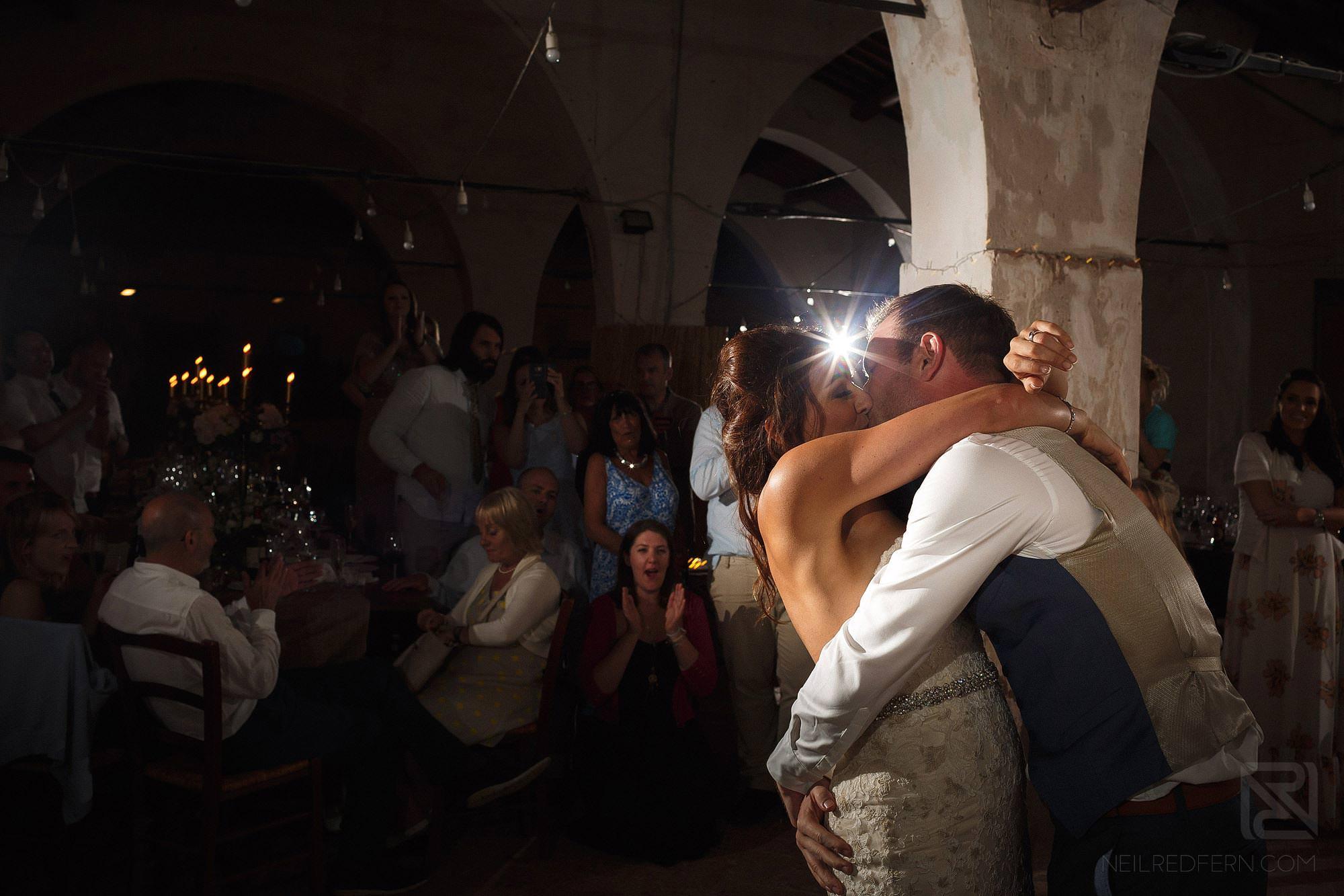 bride and groom kissing at Montestigliano wedding