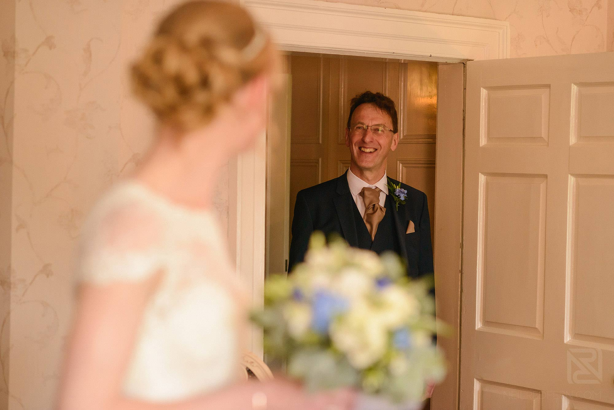 father of bride seeing bride in dress for first time