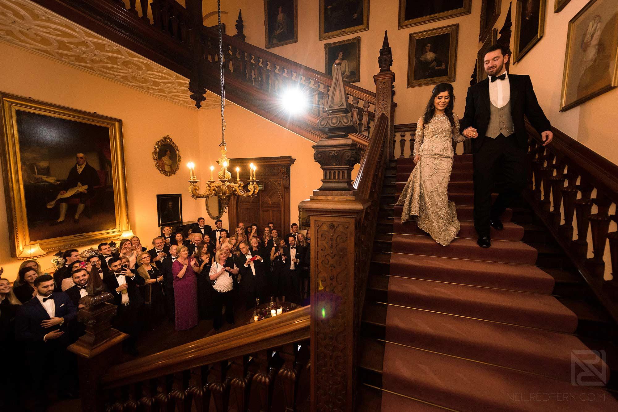 bride and groom making entrance at Arley Hall