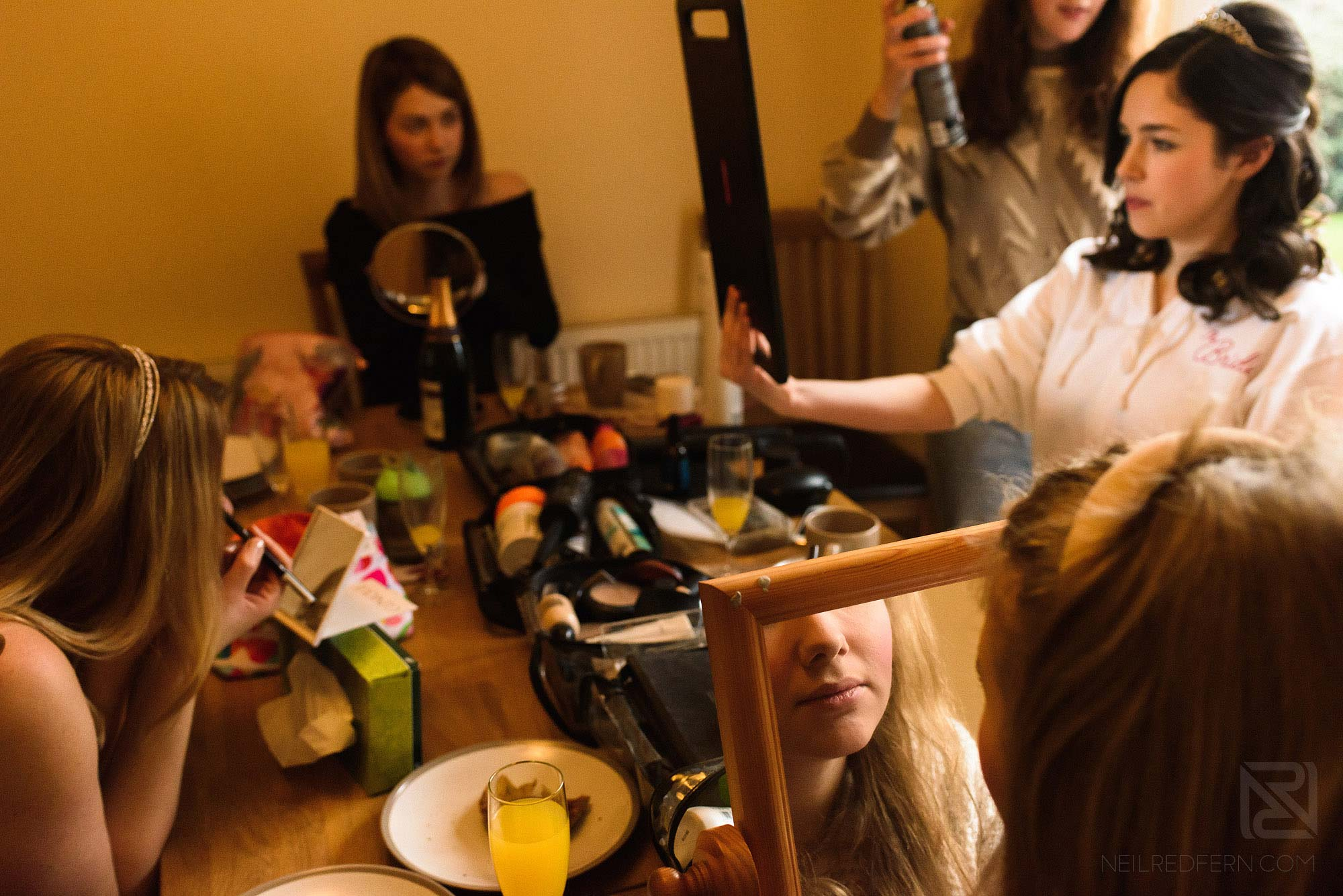 bridesmaids getting ready together on wedding morning