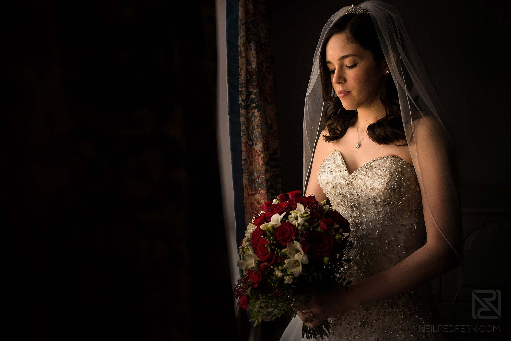 beautiful portrait of bride before leaving house