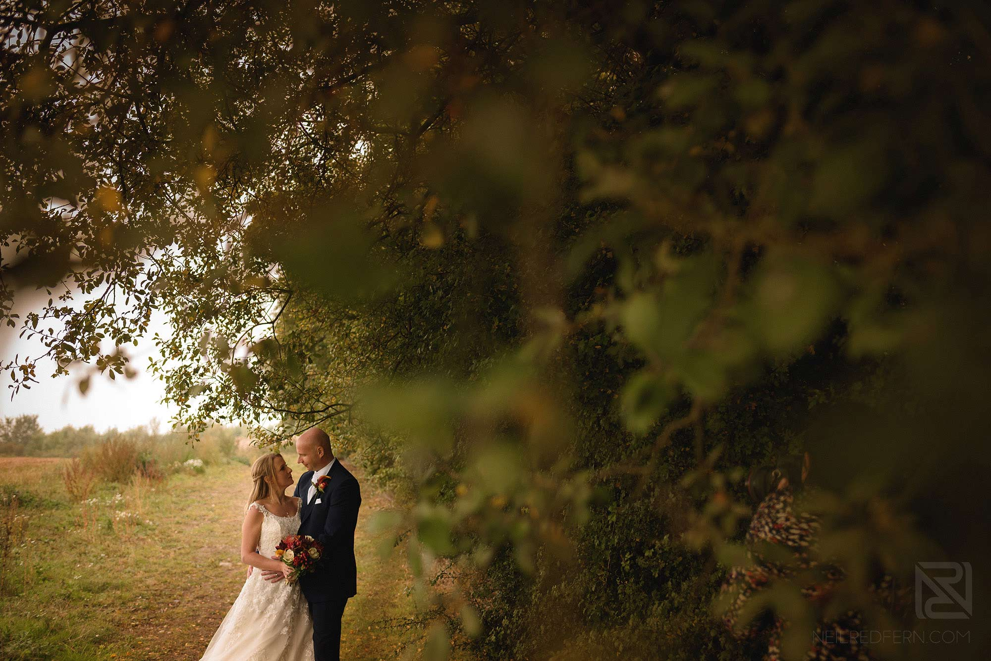 outside photograph of bride and groom at rustic wedding