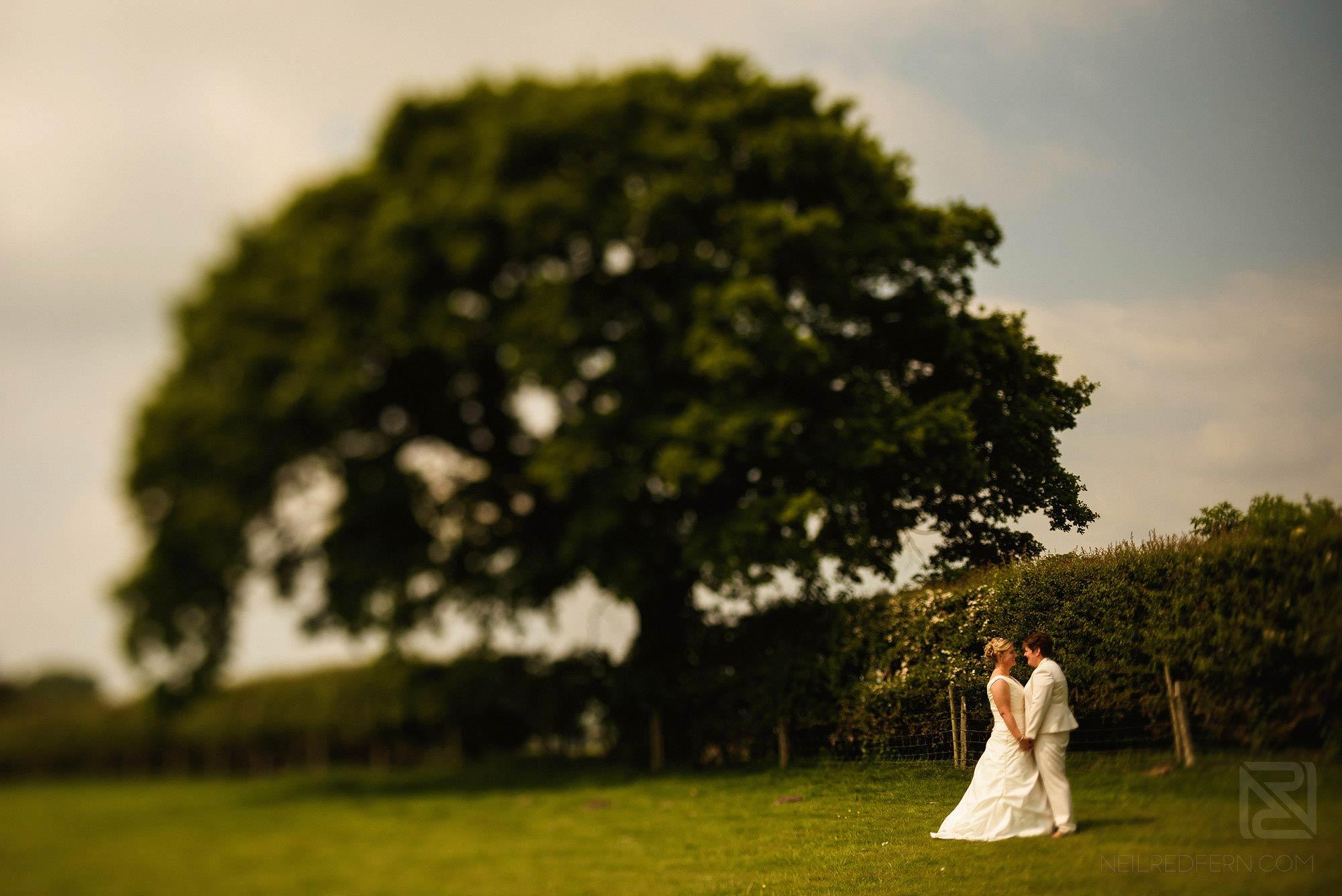 portrait of two brides at Sandhole Oak Barn