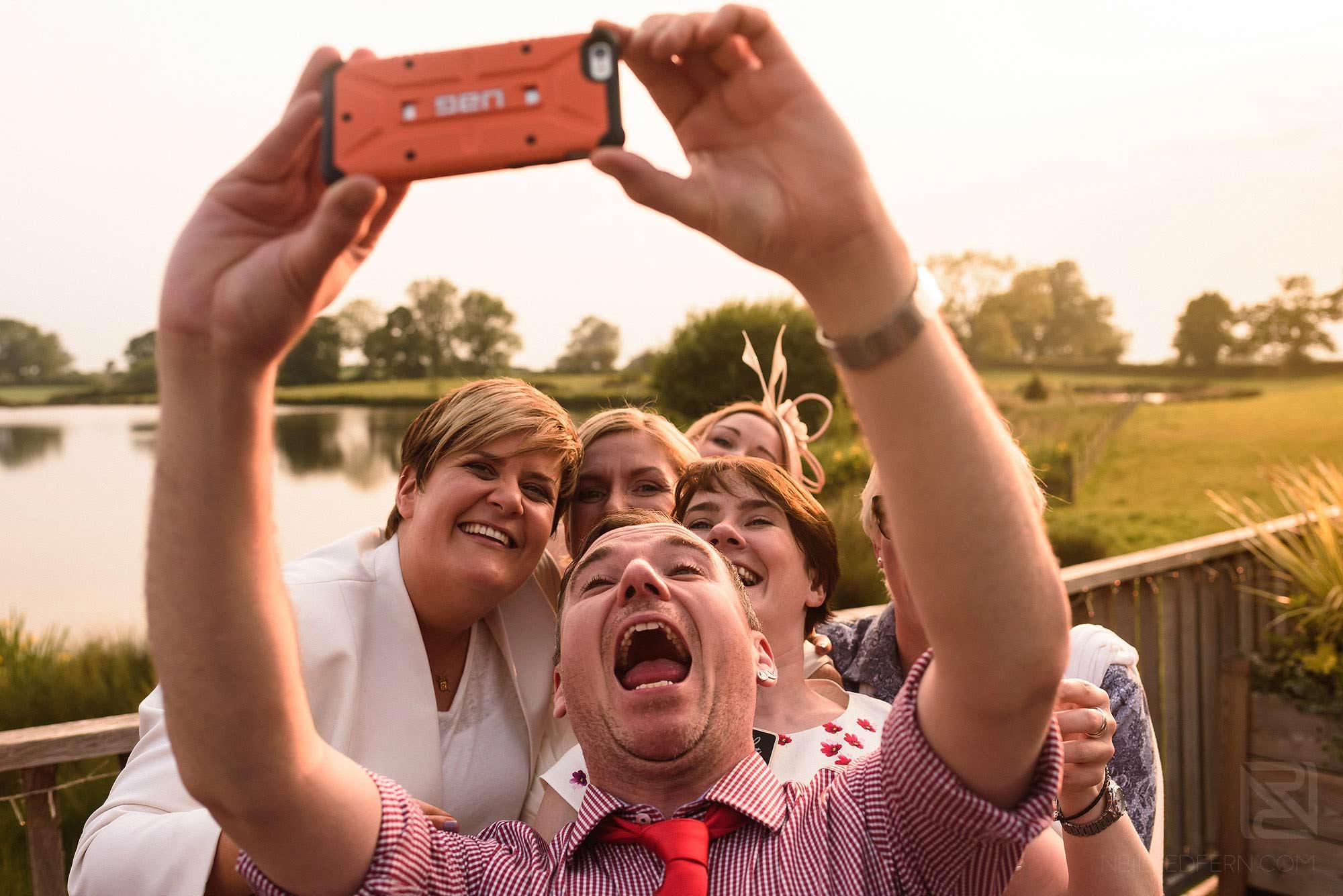 wedding guests taking selfie