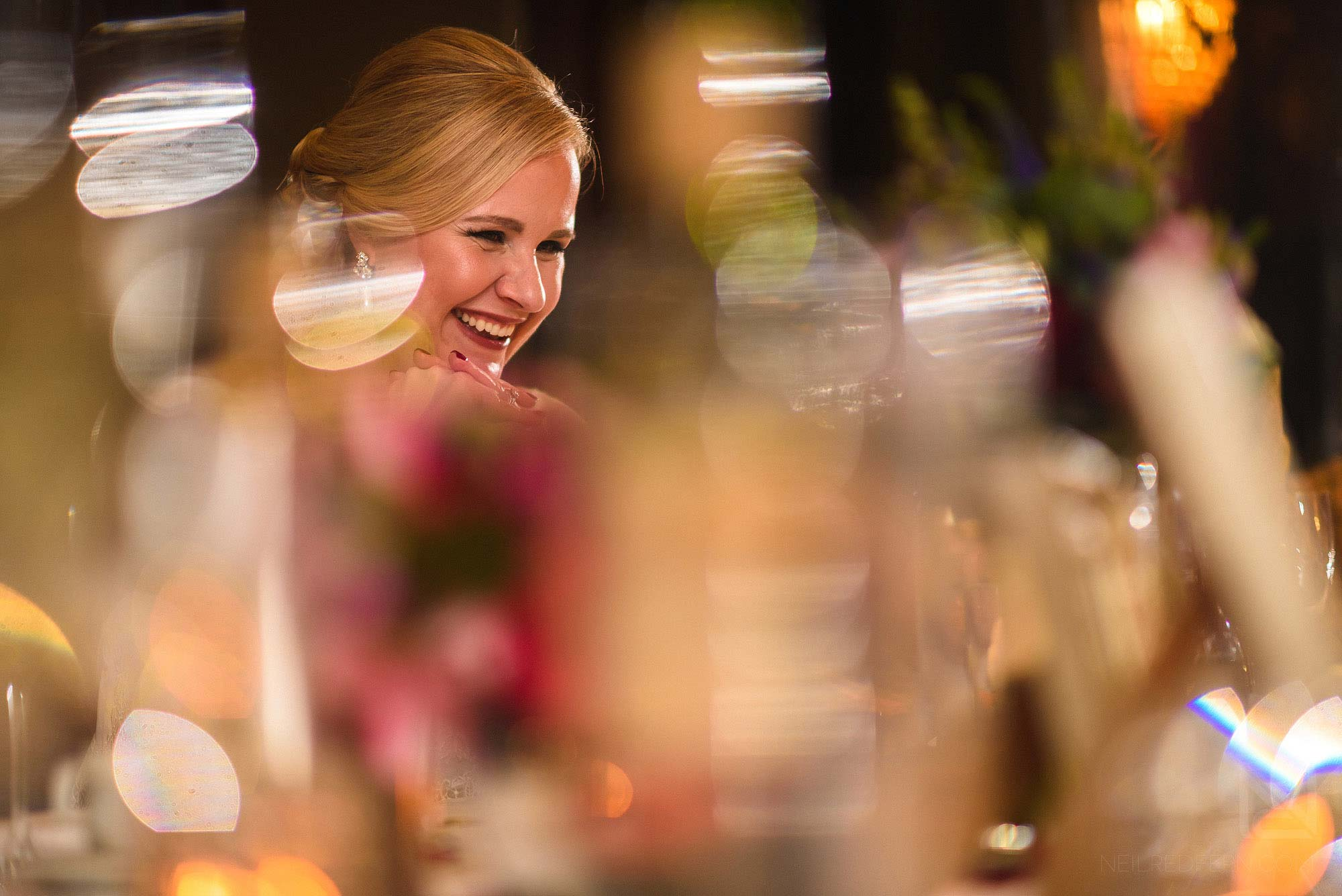 bride laughing during speeches at the Belle Epoque