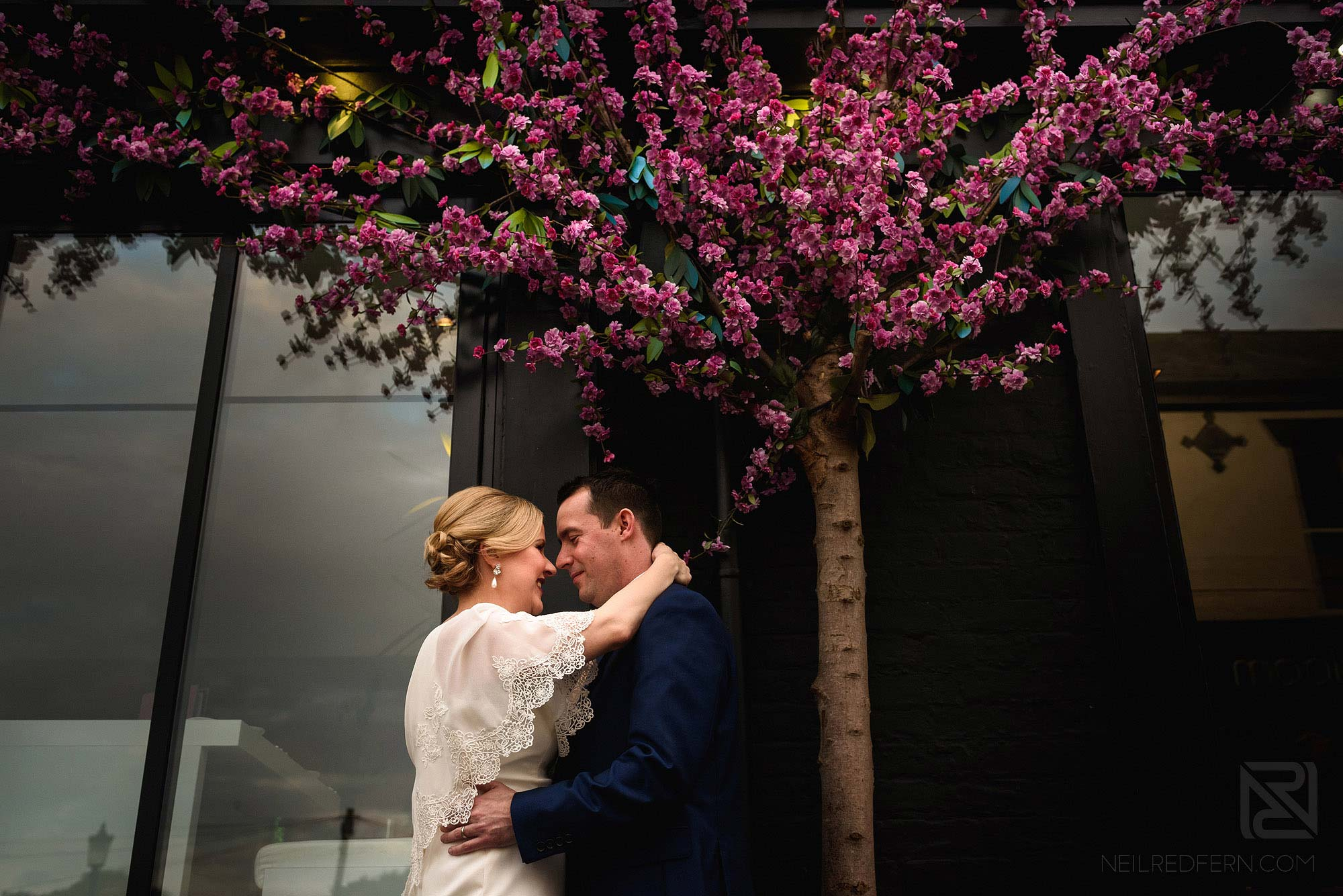 portrait photograph of bride and groom on King Street in Knutsford