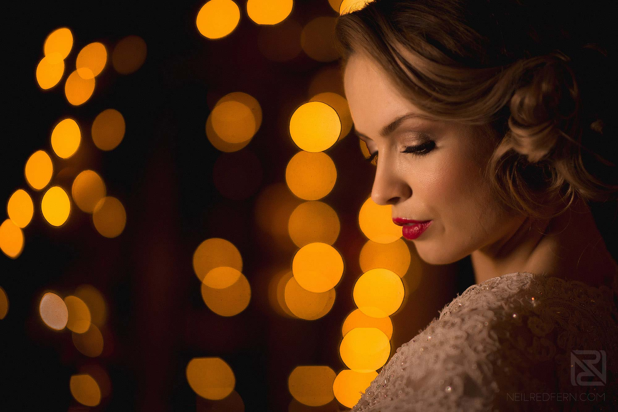 bride in front of Christmas tree at winter wedding