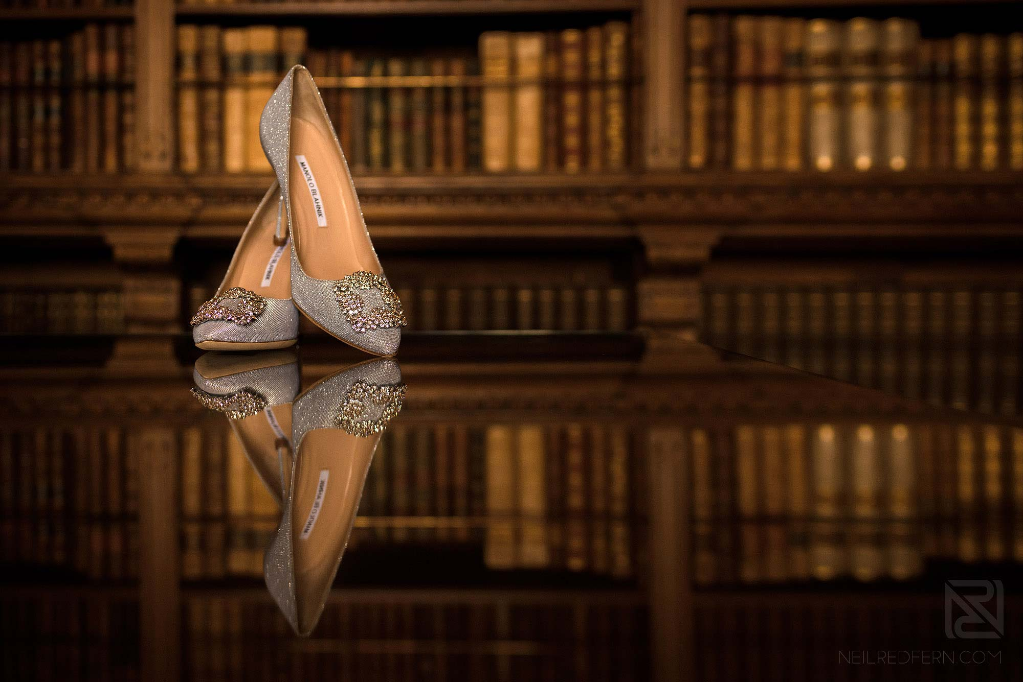 creative photograph of bride's wedding shoes