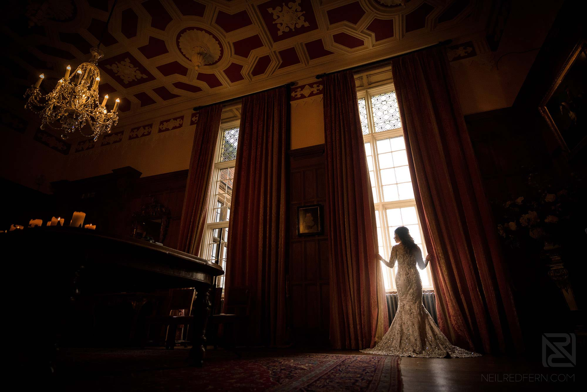 wide photograph of bride inside Arley Hall