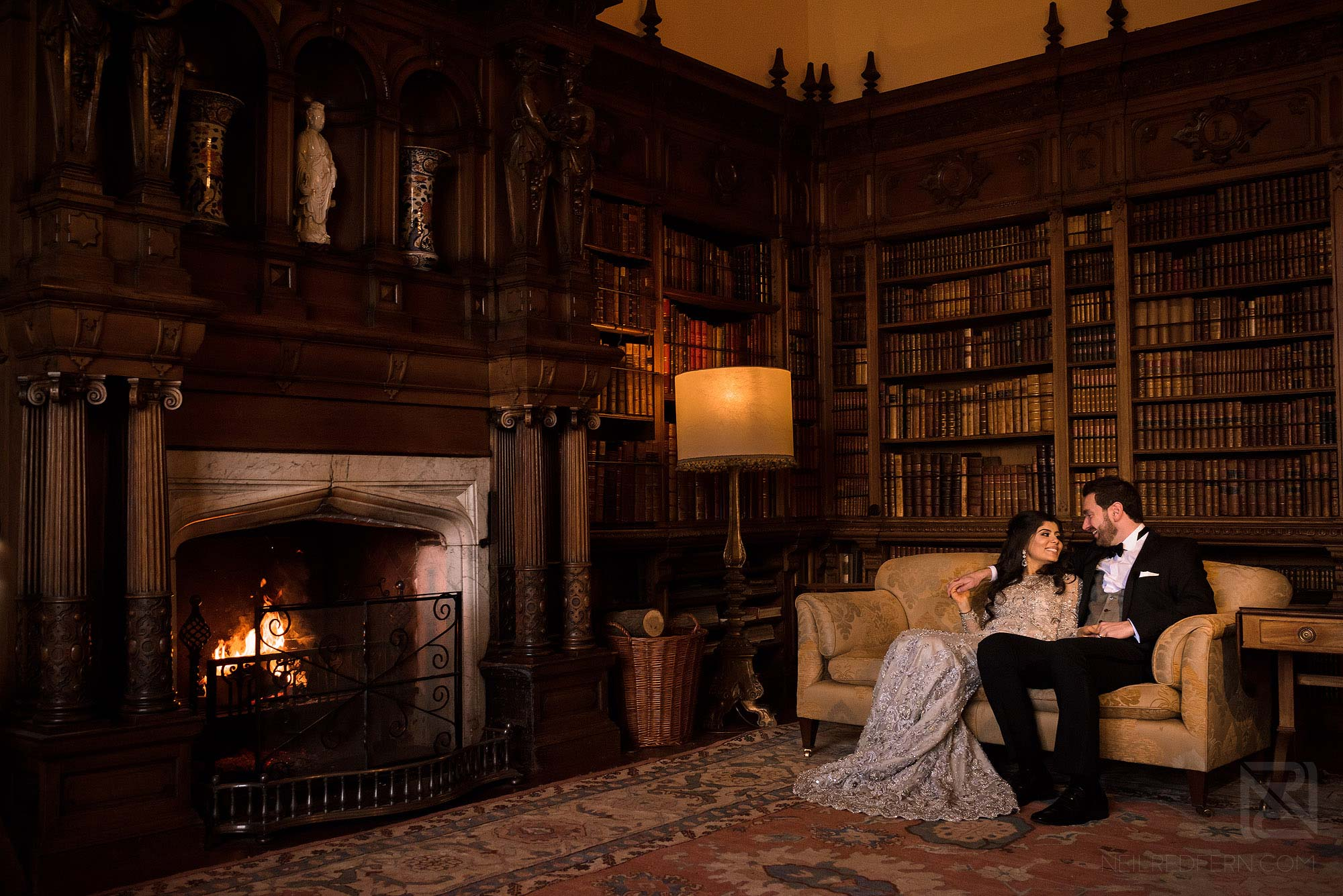 newlyweds sat together in Arley Hall Library