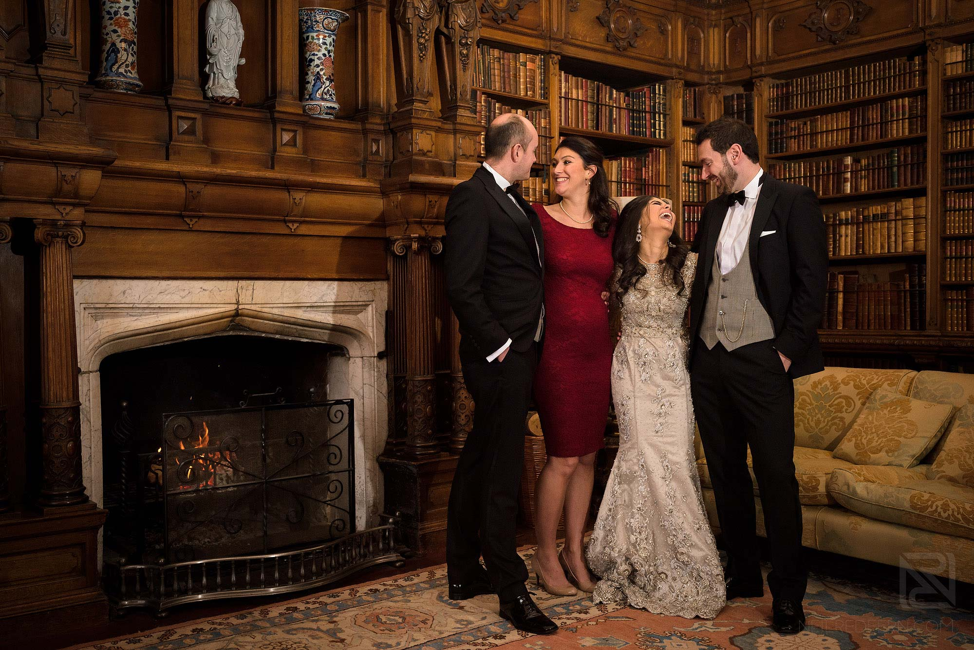 wedding group photograph in library at Arley Hall