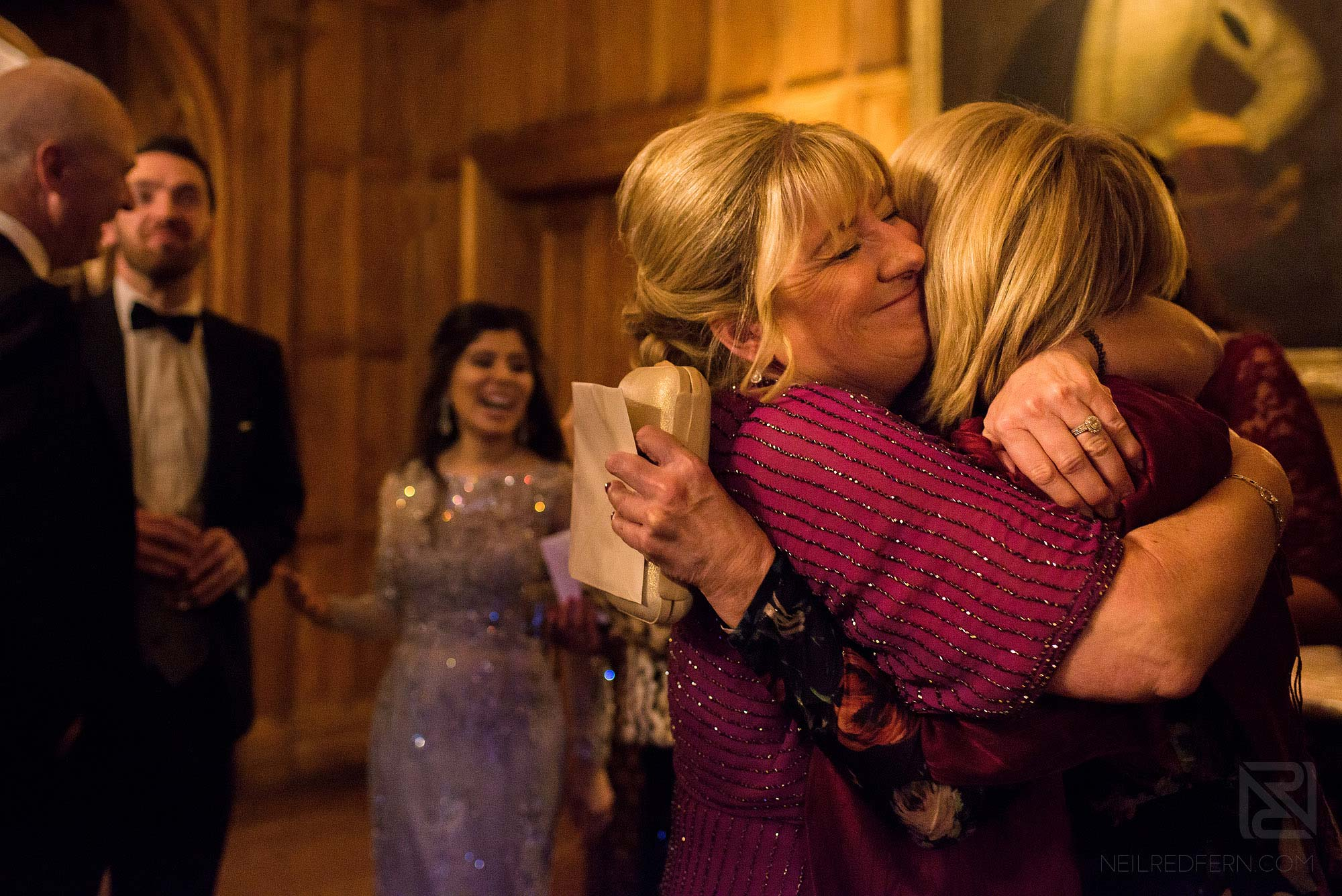 wedding guests hugging at Arley Hall winter wedding